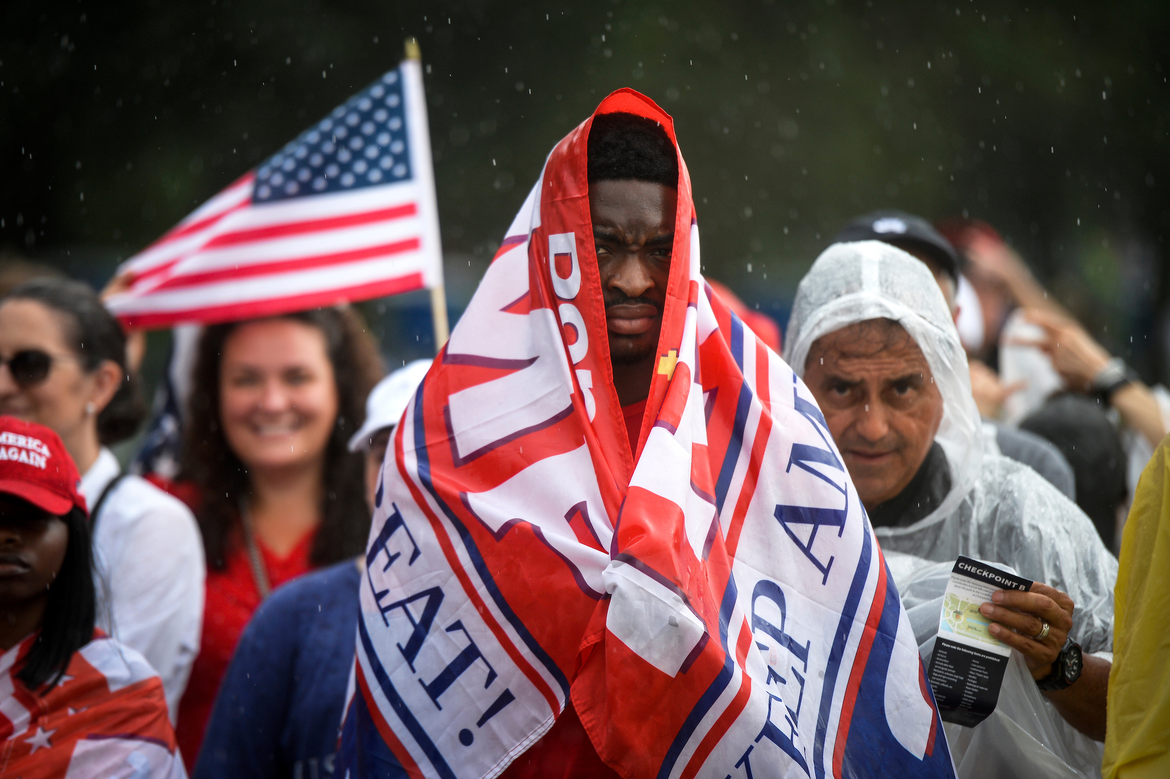 UNITED STATES - JULY 4: People shield themselves from the rain as they celebrate during an event for President Donald Trump's 'Salute to America' as an Independence Day celebration in front of the Lincoln Memorial on Thursday July 4, 2019. (Photo by Caroline Brehman/CQ Roll Call)