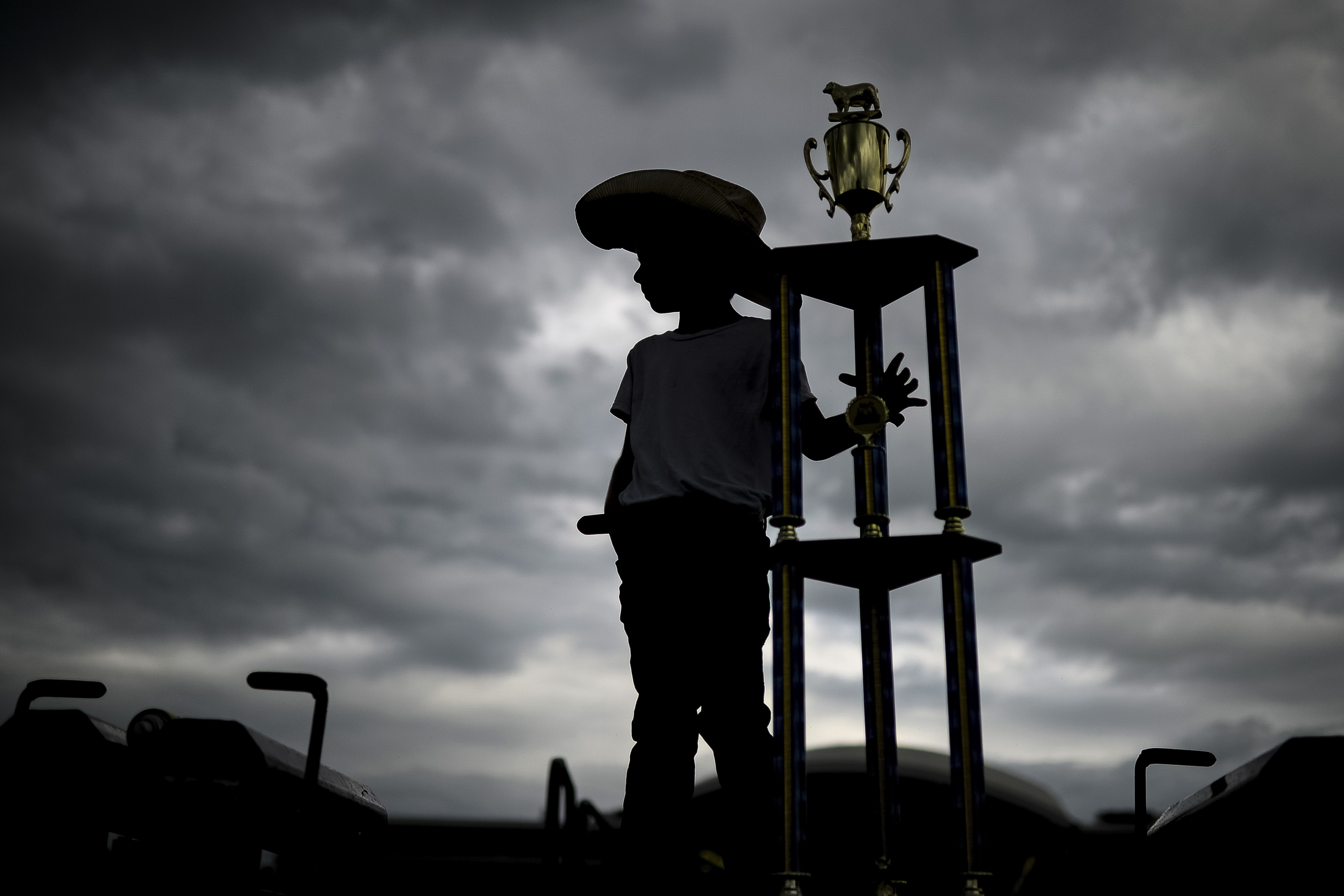 UNITED STATES - AUGUST 18: A fairgoer stands with his first place trophy after competition in the championship round of the Mutton Bustin' competition at the Iowa State Fair on Sunday August 18, 2019. (Photo by Caroline Brehman/CQ Roll Call)