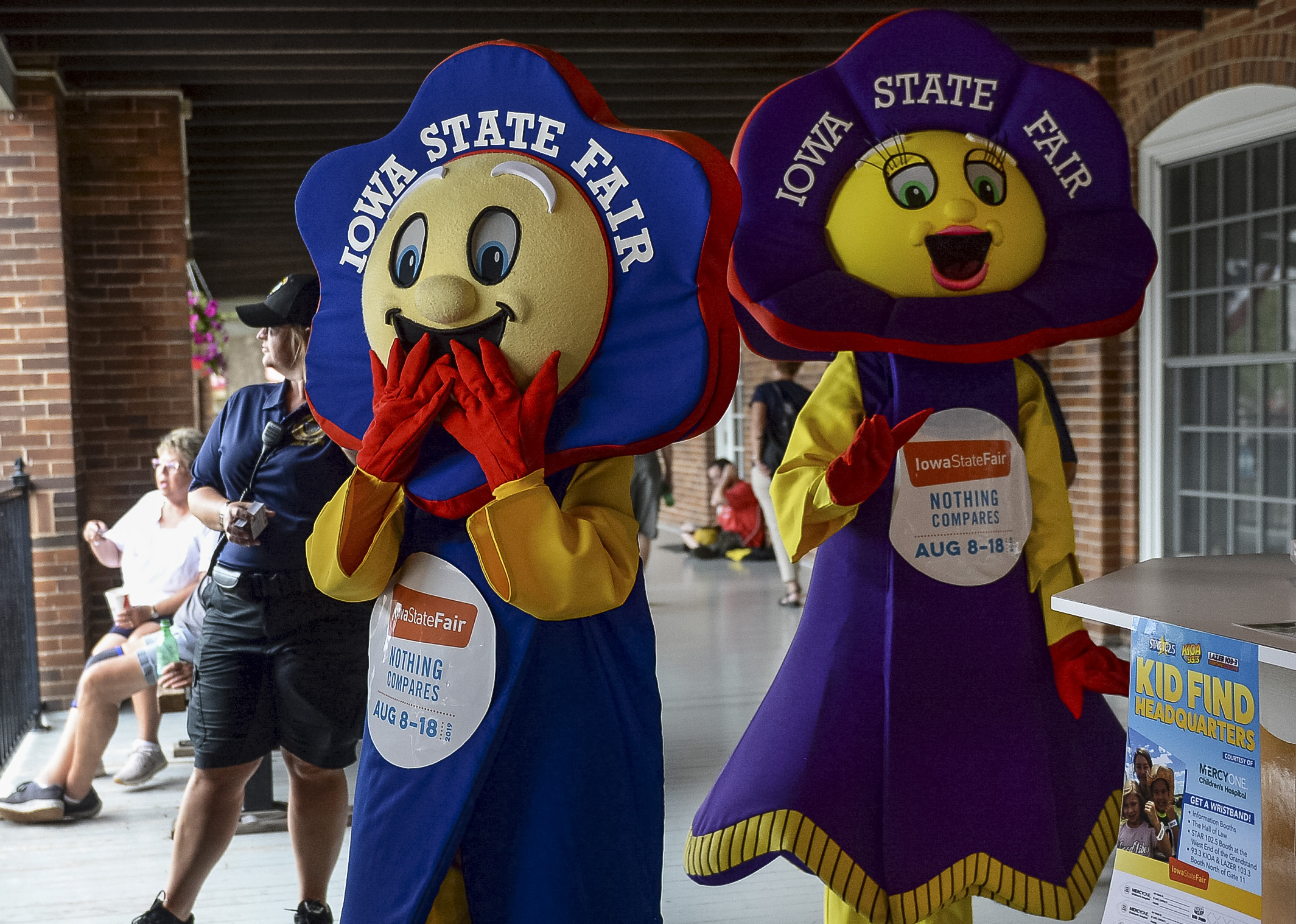 UNITED STATES - AUGUST 12: Iowa State Fair mascots walk by the Administration Building at the Iowa State Fair on Monday August 12, 2019. (Photo by Caroline Brehman/CQ Roll Call)