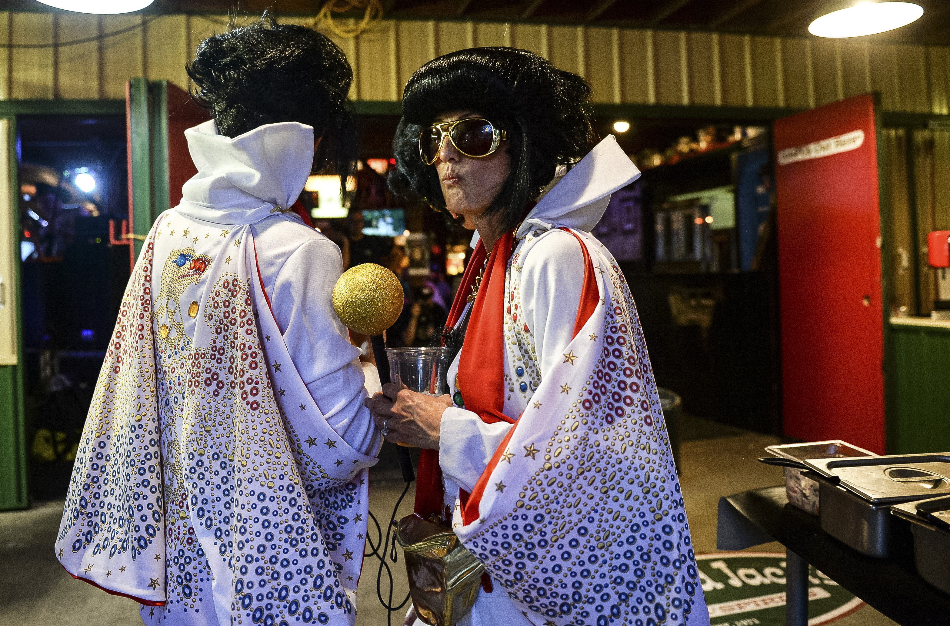 UNITED STATES - AUGUST 16: People dressed up as Elvis Presley walk around at the Iowa State Fair on Friday August 16, 2019. (Photo by Caroline Brehman/CQ Roll Call)