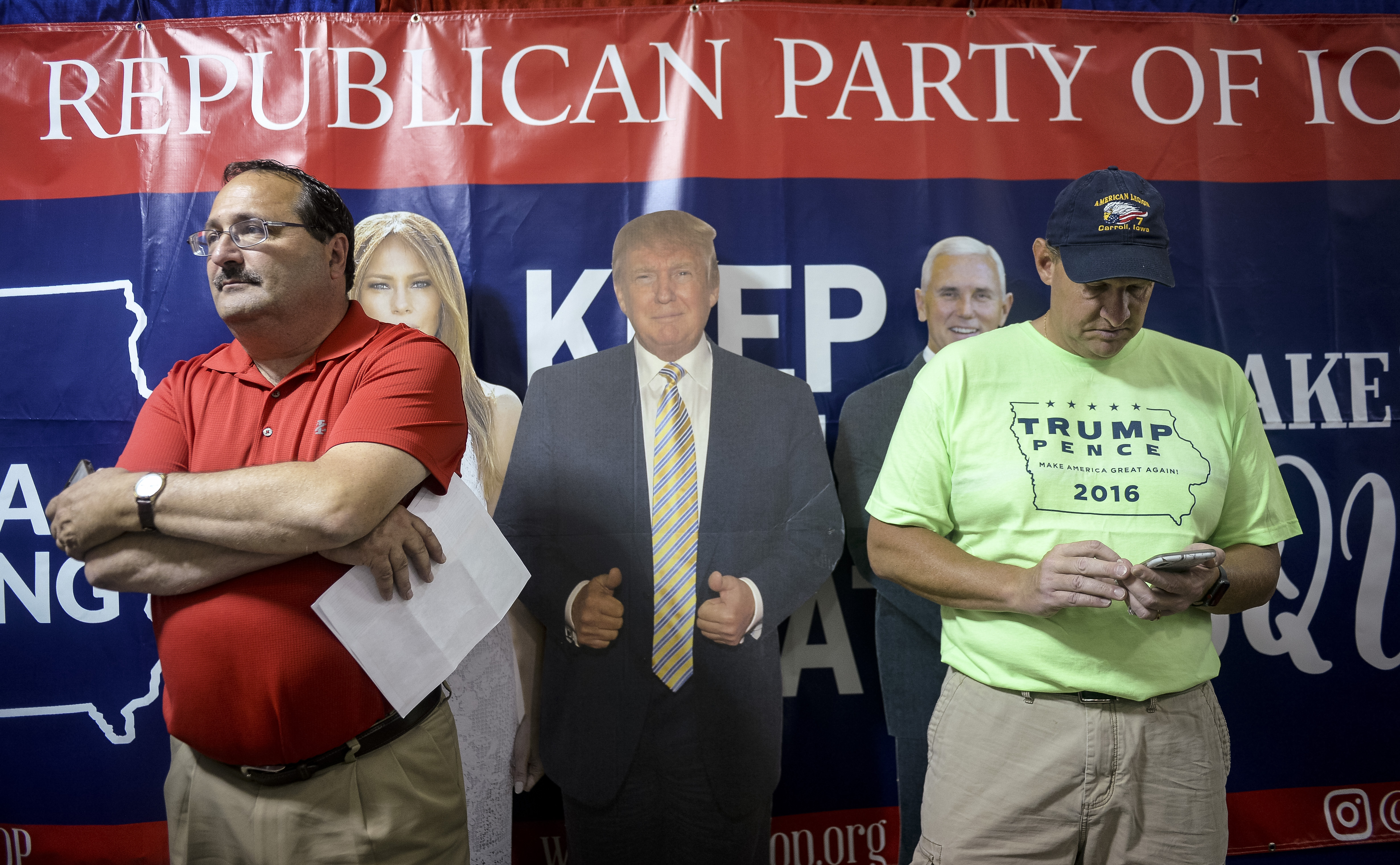 UNITED STATES - AUGUST 10: Iowa GOP Chairman Jeff Kaufmann, left, stands at the GOP booth inside the Varied Industries building at the Iowa State Fair on Saturday August 10, 2019. (Photo by Caroline Brehman/CQ Roll Call)