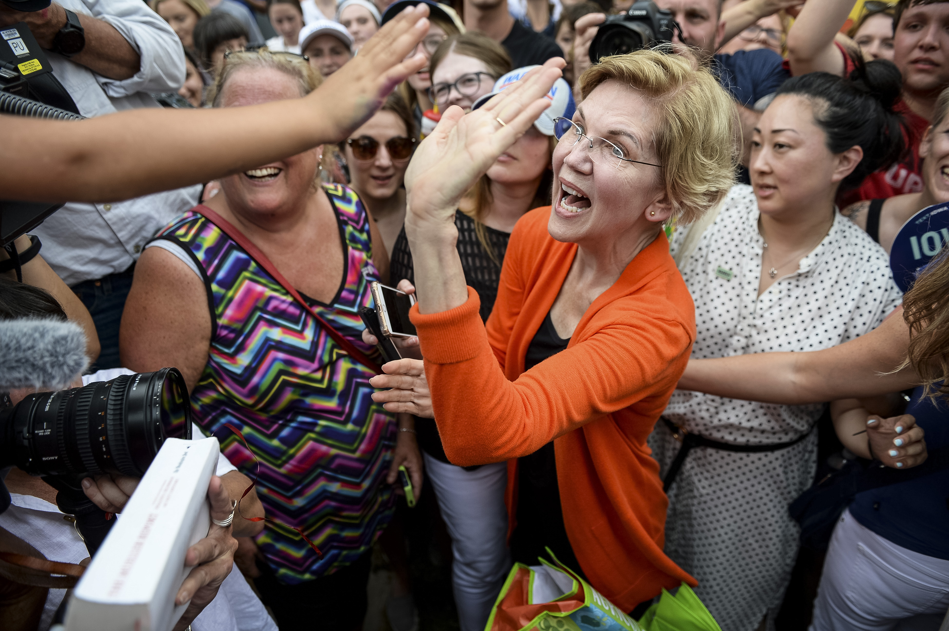UNITED STATES - AUGUST 10: Democratic presidential candidate Sen. Elizabeth Warren, D-Mass., high fives a fairgoer at the Iowa State Fair on Saturday August 10, 2019. (Photo by Caroline Brehman/CQ Roll Call)