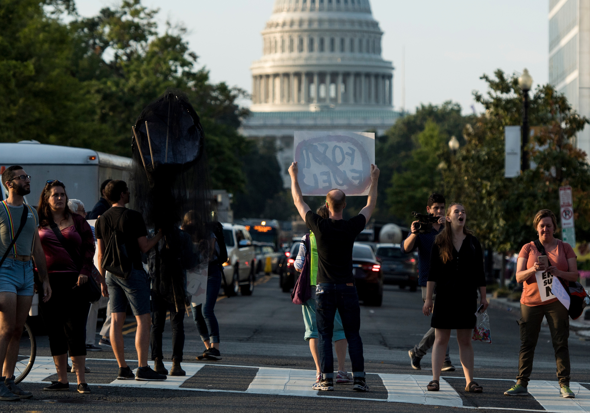 "UNITED STATES - SEPTEMBER 23: Climate change protesters block the intersection of Massachusetts Avenue and North Capitol Street near the U.S. Capitol at rush hour on Monday, Sept. 23, 2019. A coalition of climate activists under the umbrella ""Shut Down D.C."" blocked intersections throughout DC to draw attention to climate change. (Photo By Bill Clark/CQ Roll Call)"