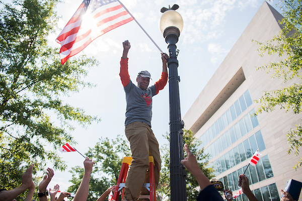 UNITED STATES - SEPTEMBER 16: Army veteran Bernie Siler, 67, installs a flag with 51 stars during a rally on Pennsylvania Avenue, NW, with 51 military veterans ahead of this week's House Oversight and Reform Committee hearing on a bill that would make D.C. the 51st state, on Monday, September 16, 2019. (Photo By Tom Williams/CQ Roll Call)