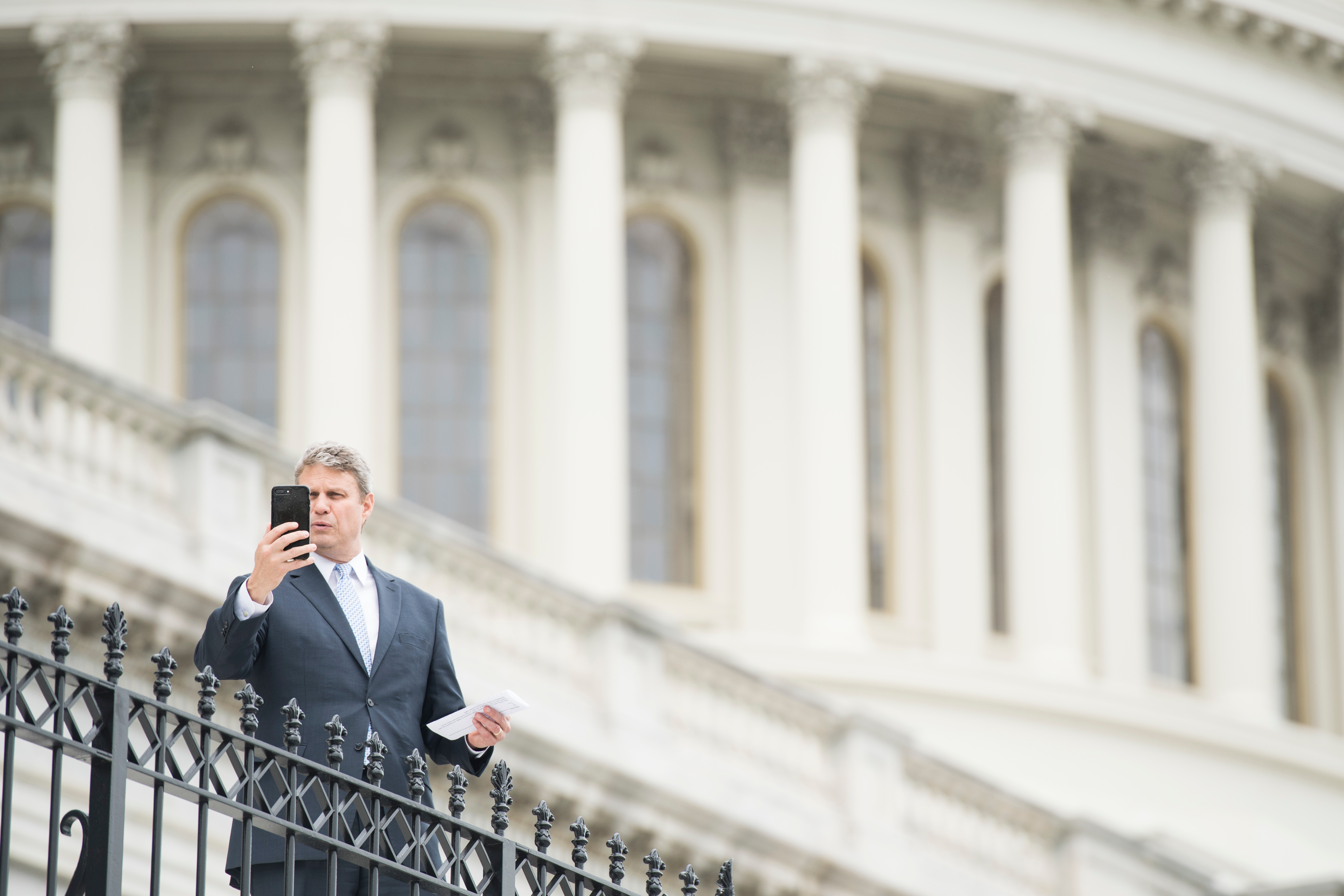 UNITED STATES - MAY 17: Rep. Bill Huizenga, R-Mich., films a selfie video outside of the Capitol in between votes on Friday, May 17, 2019. (Photo By Bill Clark/CQ Roll Call)