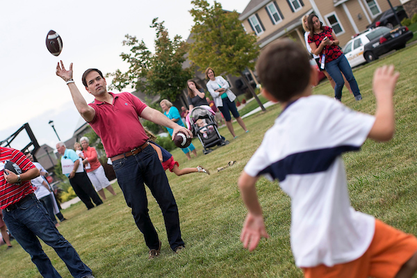 UNITED STATES - August 17: Republican presidential candidate Sen. Marco Rubio, R-Fla., throws a football with children during a Family Night event at Dean Park in Ankeny, Iowa, Monday, August 17, 2015. (Photo By Al Drago/CQ Roll Call)