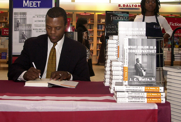 "watts3/121802 - Rep. J.C. Watts, R-Ok., at a book store in Union Station siging his new book, ""What Color is a Conservative?""."