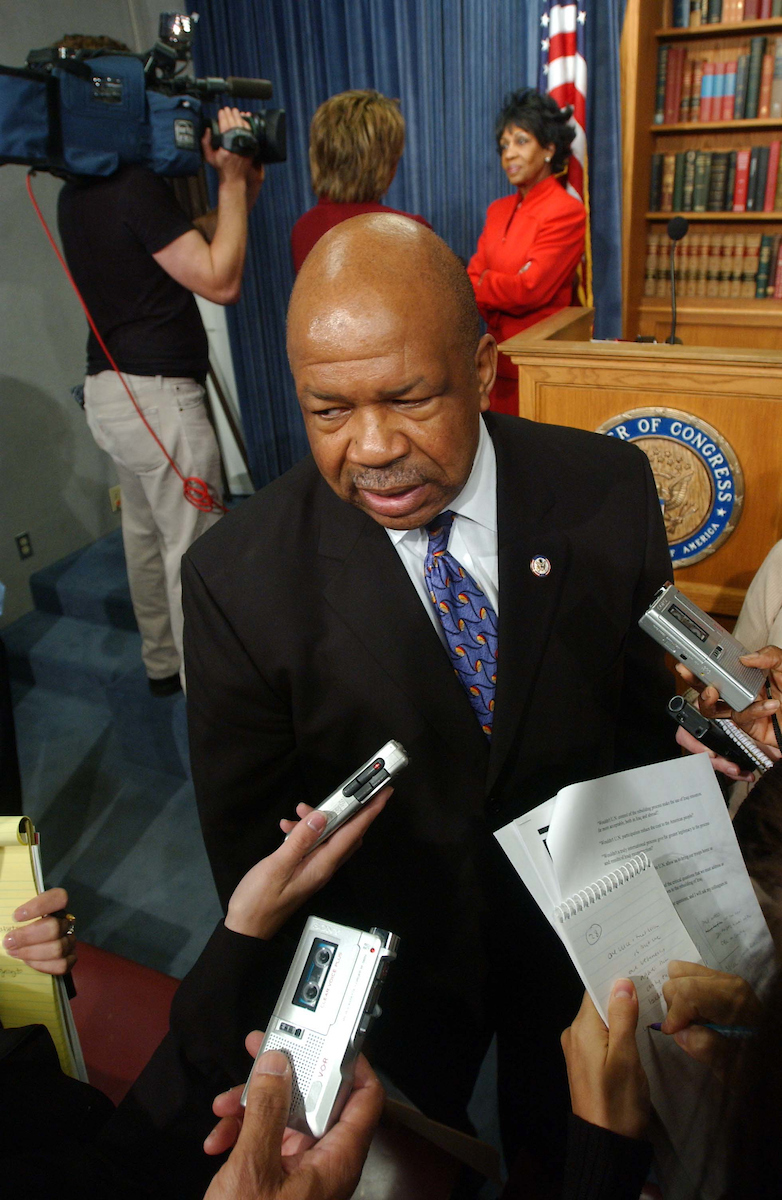 10/15/03.IRAQ SUPPLEMENTAL/CONGRESSIONAL BLACK CAUCUS--CBC Chairman Elijah E. Cummings, D-Md., talks to reporters after a news conference on the $87 billion request by the administration on Iraq and Afghanistan. Maxine Waters, D-Calif., is in background right..CONGRESSIONAL QUARTERLY PHOTO BY SCOTT J. FERRELL