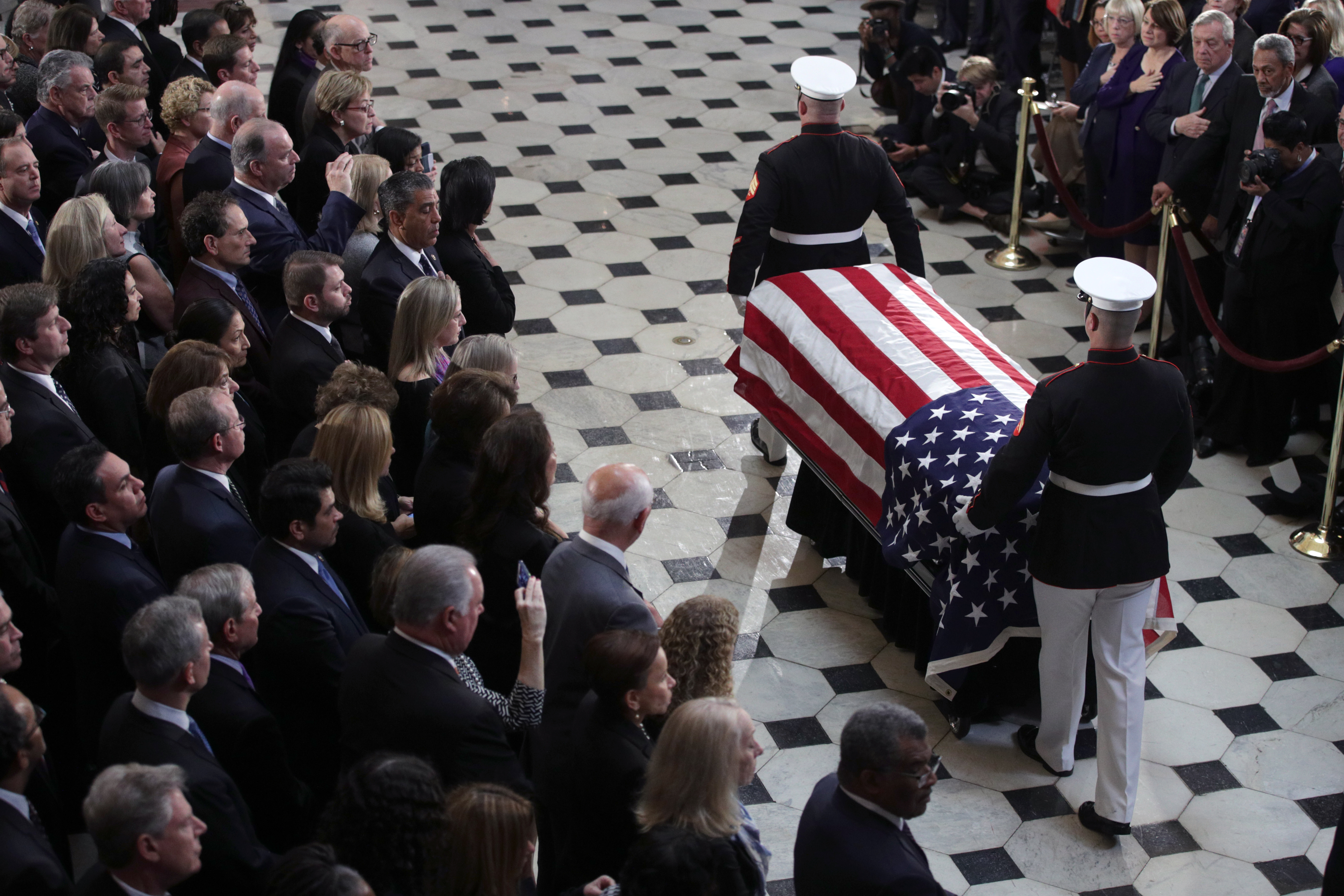 "*** POOL ***WASHINGTON, DC - OCTOBER 24: The flag-draped casket of U.S. Rep. Elijah Cummings (D-MD) is escorted by a honor guard during a memorial service at the Statuary Hall of the U.S. Capitol October 24, 2019 in Washington, DC. Rep. Cummings passed away on October 17, 2019 at the age of 68 from ""complications concerning longstanding health challenges."" (Photo by Alex Wong/Getty Images)"