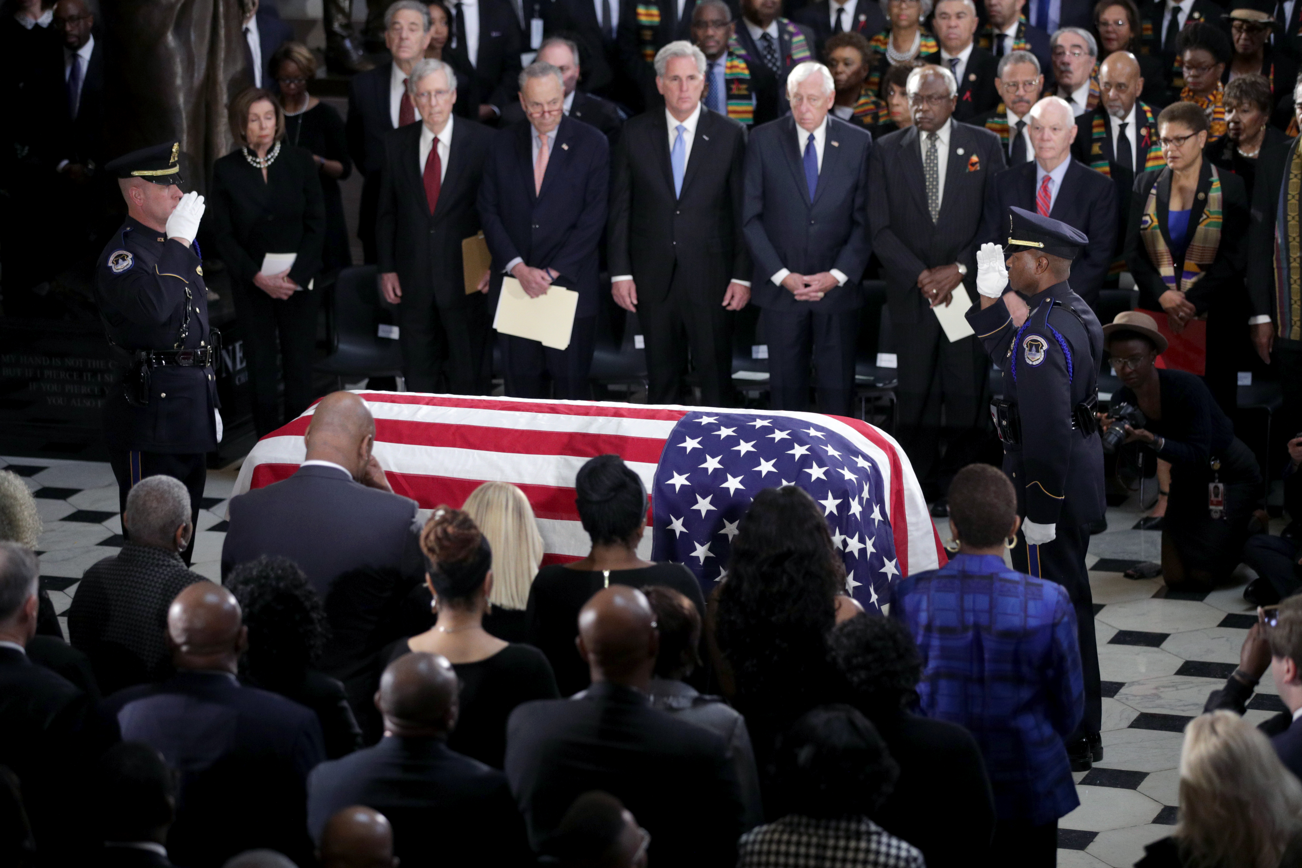 "*** POOL ***WASHINGTON, DC - OCTOBER 24: The flag-draped casket of U.S. Rep. Elijah Cummings (D-MD) is seen as the late congressman lies in state during a memorial service at the Statuary Hall of the U.S. Capitol October 24, 2019 in Washington, DC. Rep. Cummings passed away on October 17, 2019 at the age of 68 from ""complications concerning longstanding health challenges."" (Photo by Alex Wong/Getty Images)"