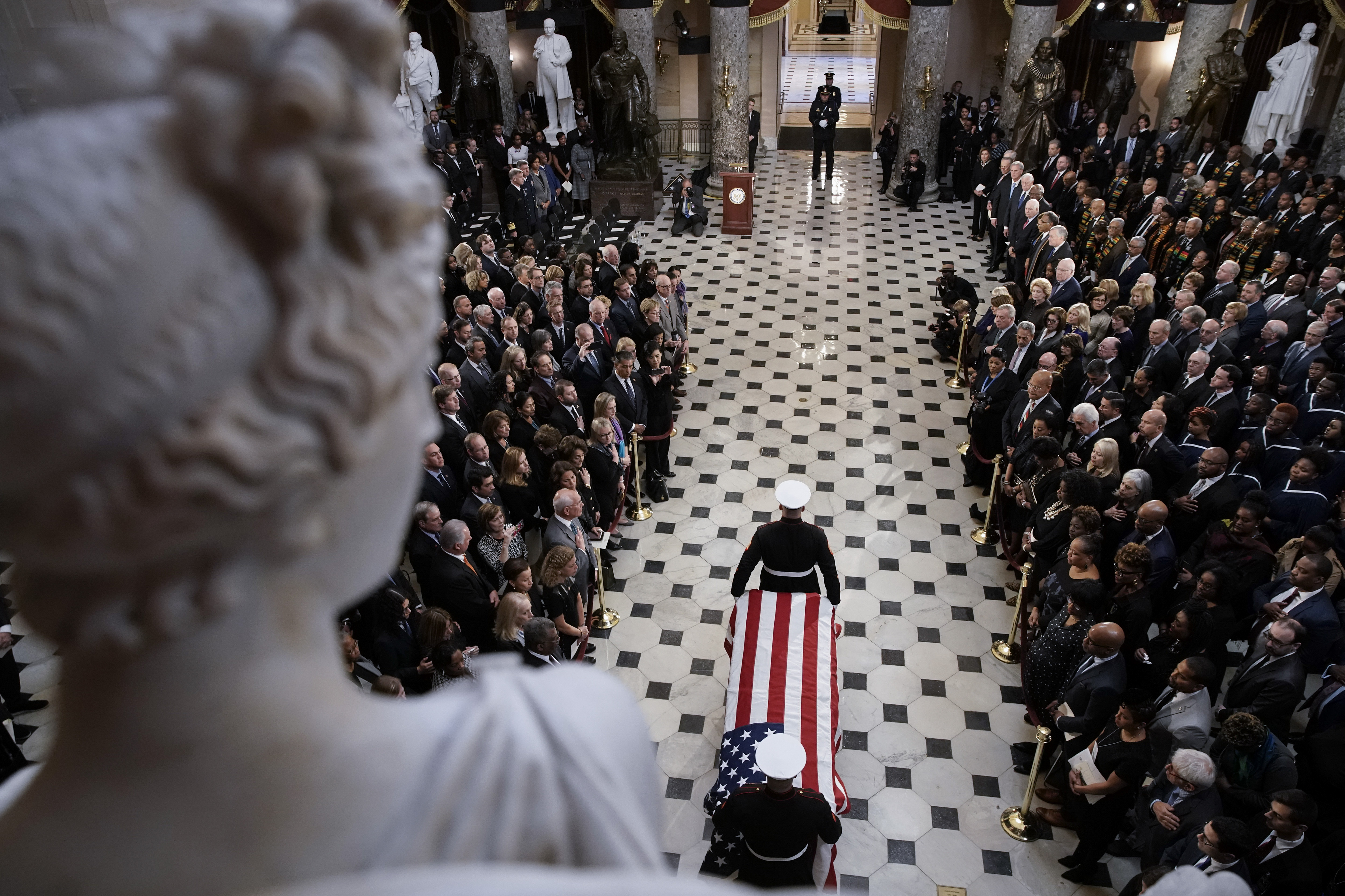 "WASHINGTON, DC - OCTOBER 24: The flag-draped casket of U.S. Rep. Elijah Cummings (D-MD) is escorted by a military honor guard to National Statuary Hall in the U.S. Capitol for a memorial service October 24, 2019 in Washington, DC. Rep. Cummings passed away on October 17, 2019 at the age of 68 from ""complications concerning longstanding health challenges."" (Photo by Al Drago-Pool/Getty Images)"