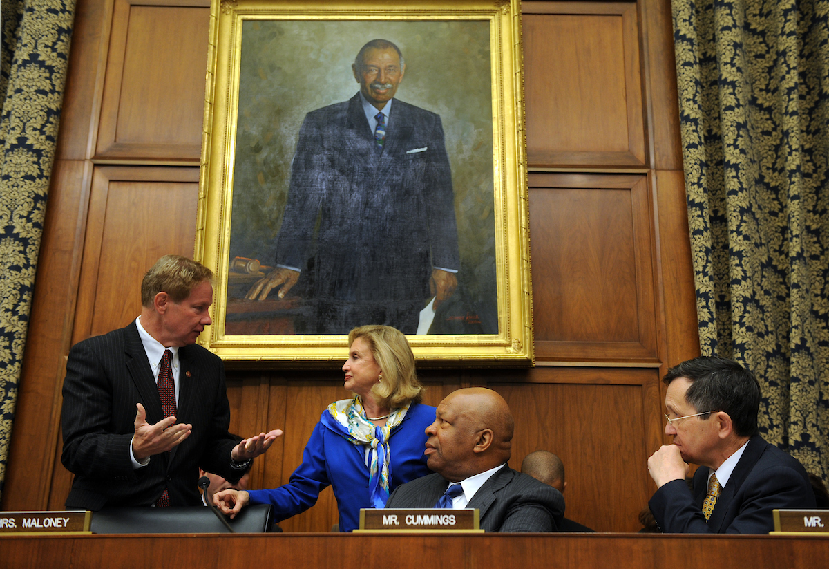 From left, Reps. Tom Davis, R-Va., Carolyn Maloney, D-N.Y., Elijah Cummings, D-Md., and Dennis Kucinich, D-Ohio, confer before a House Oversight and Government Reform Committee hearing on the role of the credit rating agencies in the financial crisis of Wall Street markets, October 22, 2008.