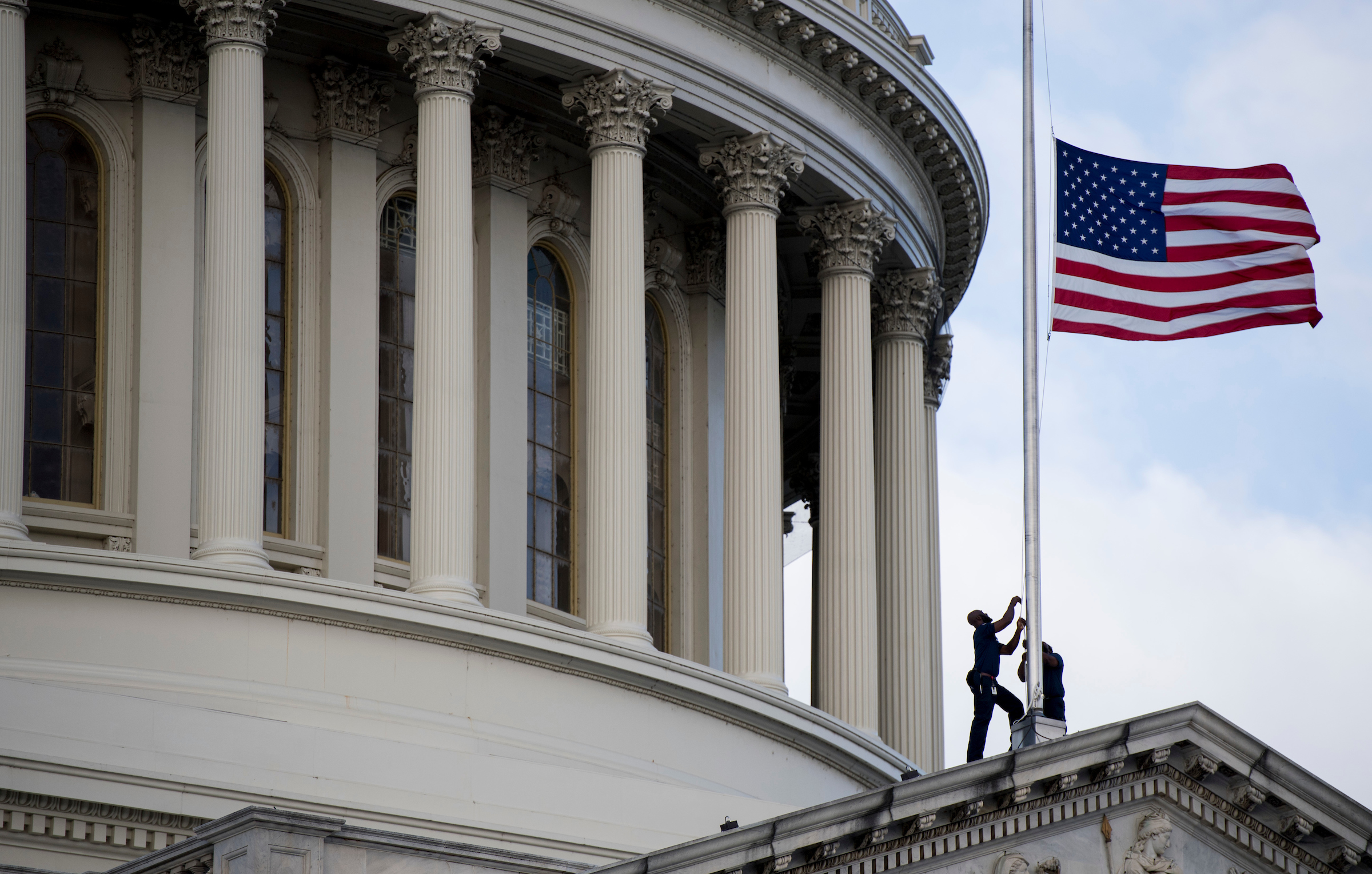 UNITED STATES - OCTOBER 17: Capitol workers lower the flag to half staff after the passing of Rep. Elijah Cummings, D-Md., on Thursday, Oct. 17, 2019. (Photo By Bill Clark/CQ Roll Call)