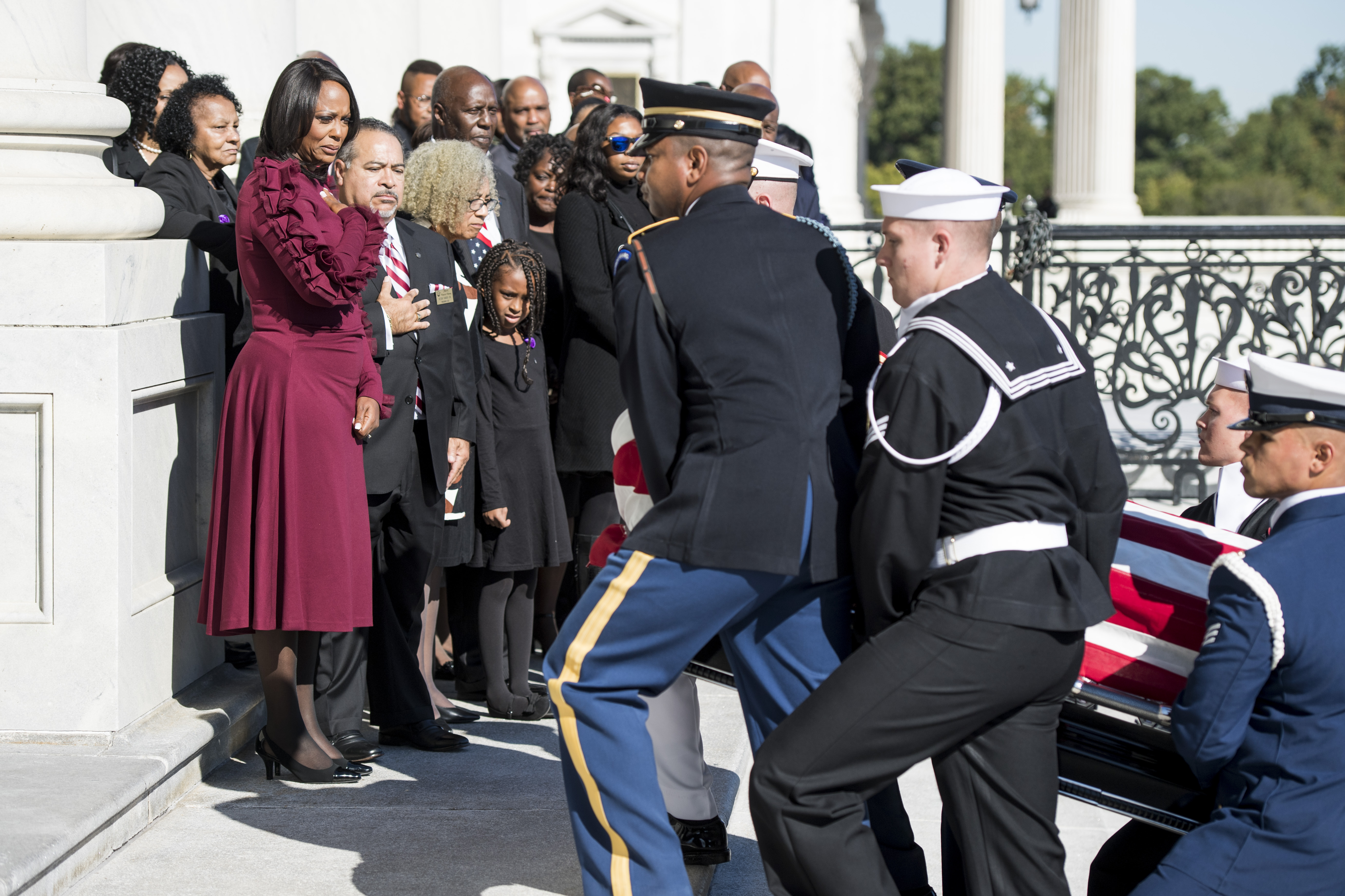 UNITED STATES - OCTOBER 24: Rep. Elijah CummingsÕ widow Maya Rockeymoore and family members look on as the flag-draped casket of Rep. Elijah Cummings, D-Md., is carried by members of the honor guard up the steps of the U.S. Capitol in Washington, on Thursday, Oct. 24, 2019. (POOL Photo By Bill Clark/CQ Roll Call)