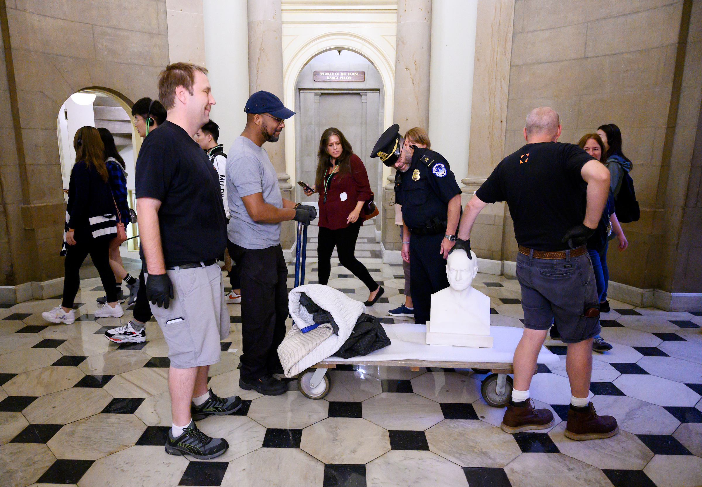 UNITED STATES - SEPTEMBER 30: Workers move the bust of John Quincy Adams through the Capitol past Speaker Pelosi's office on Monday, Sept. 30, 2019. (Photo By Bill Clark/CQ Roll Call)