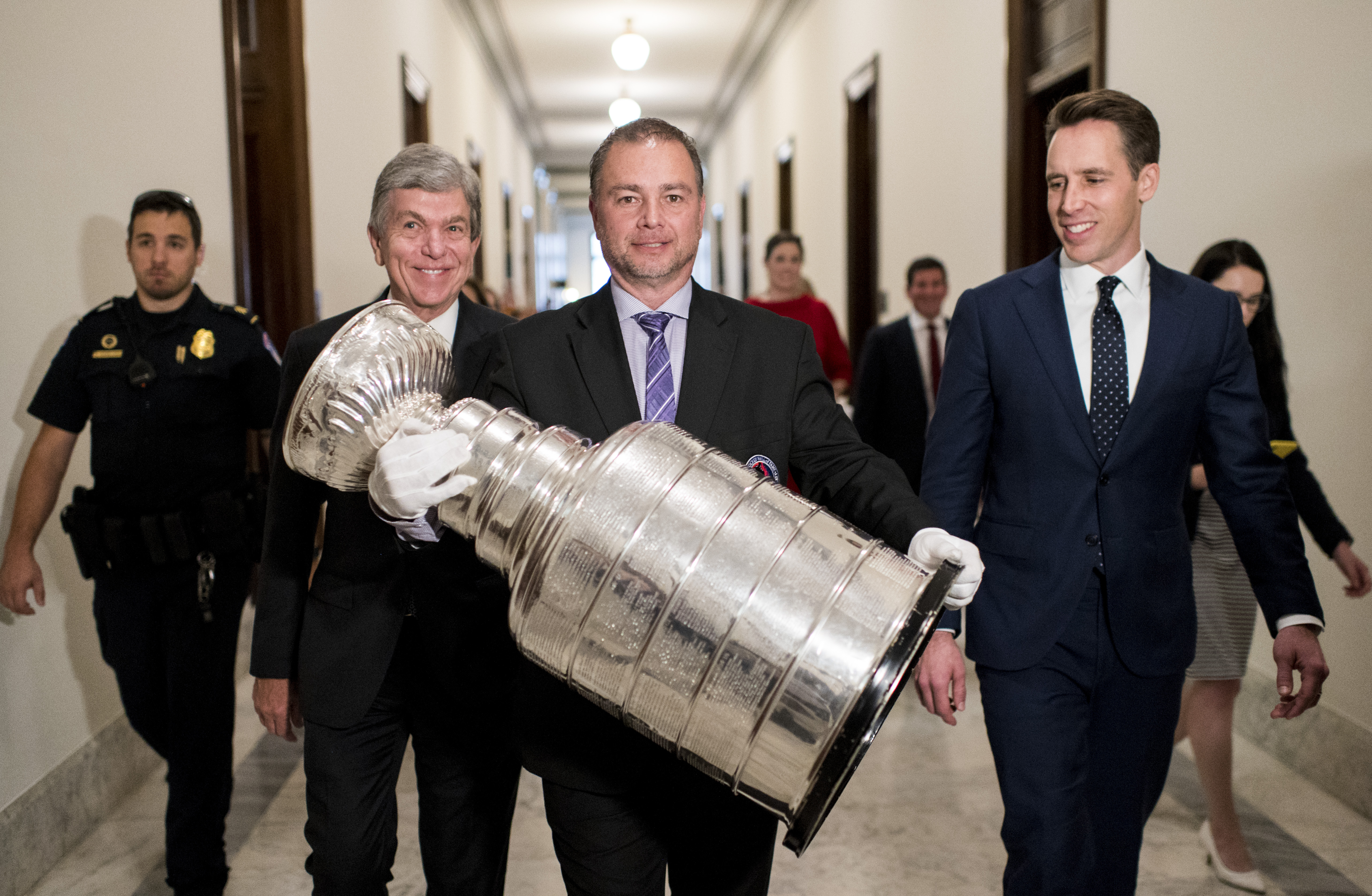 UNITED STATES - OCTOBER 16: Sen. Roy Blunt, R-Mo., and Sen. Josh Hawley, R-Mo., escort the Stanley Cup to the Kennedy Caucus Room in the Russell Senate Office Building on Wednesday, Oct. 16, 2019. The St. Louis Blues won the cup this year. (Photo By Bill Clark/CQ Roll Call)