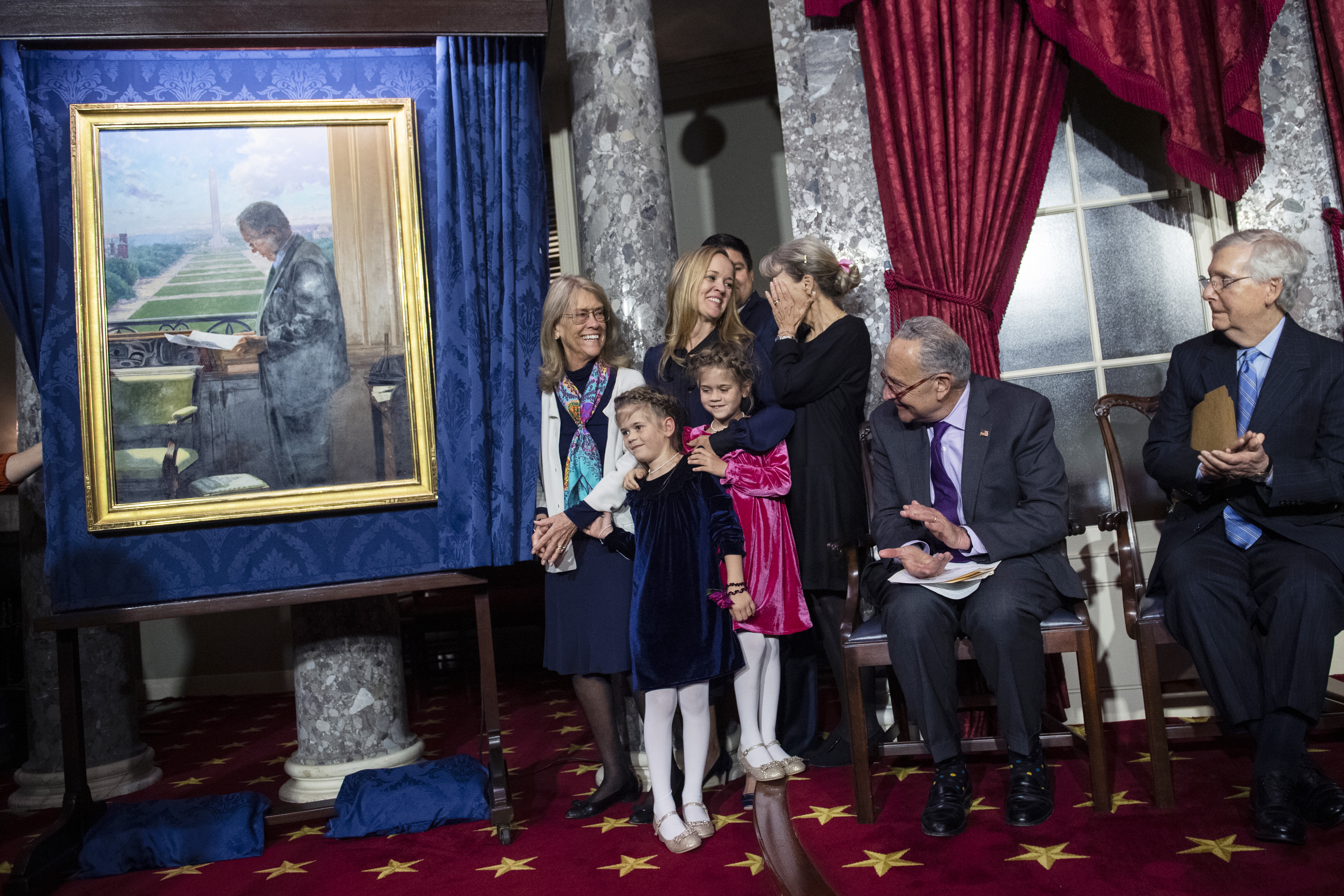UNITED STATES - OCTOBER 23: Catherine Stevens, far left, the widow of the late Sen. Ted Stevens, R-Alaska, attends the portrait unveiling for the Senator, with family members Senate Majority Leader Mitch McConnell, R-Ky., right, and Senate Minority Leader Charles Schumer, D-N.Y., in the Old Senate Chamber on Wednesday, October 23, 2019. (Photo By Tom Williams/CQ Roll Call),