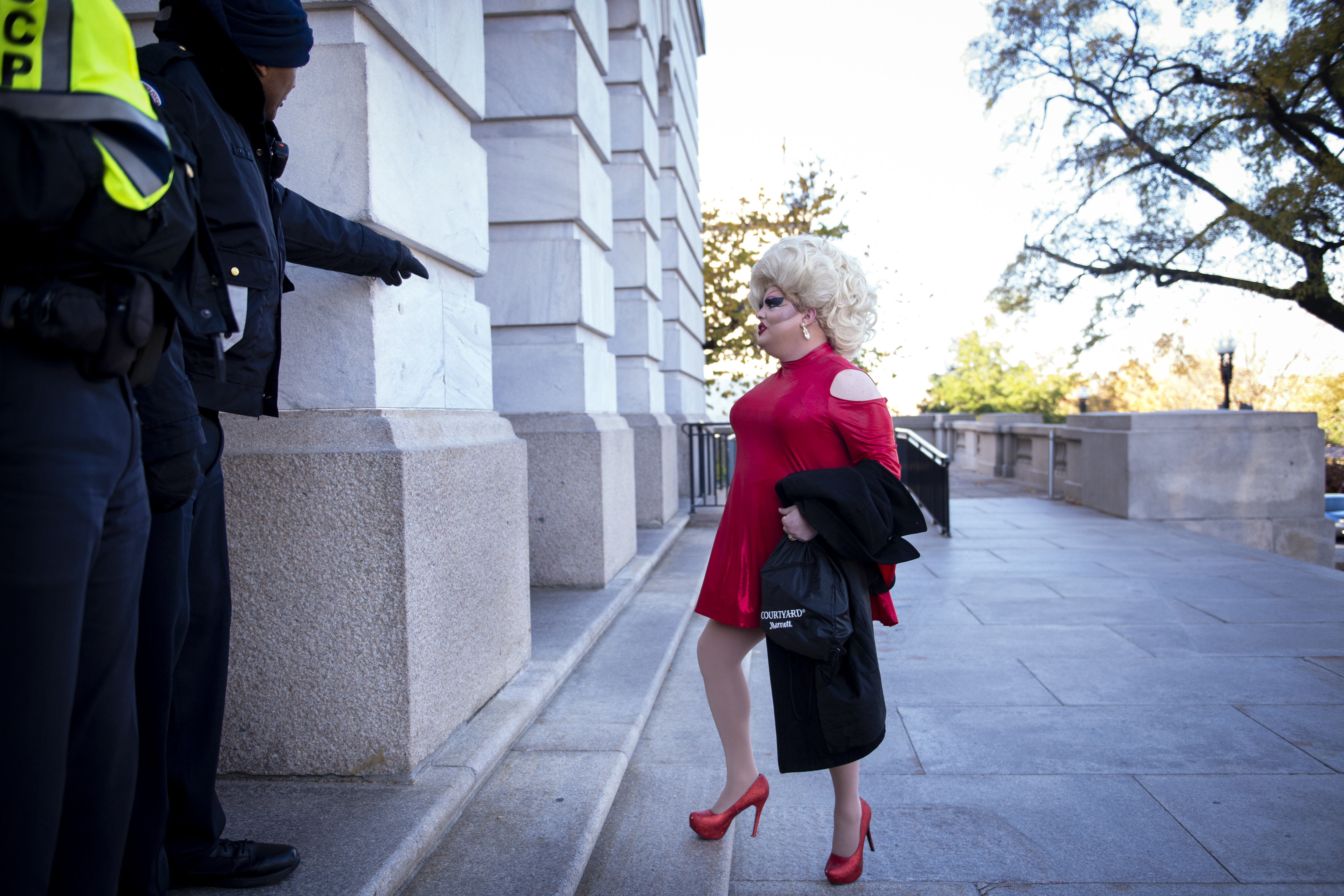 UNITED STATES - NOVEMBER 13: A person dressed in drag arrives for the House Intelligence Committee hearing on the impeachment inquiry of President Trump outside of the Longworth Building on Wednesday Nov. 13, 2019. (Photo by Caroline Brehman/CQ Roll Call)