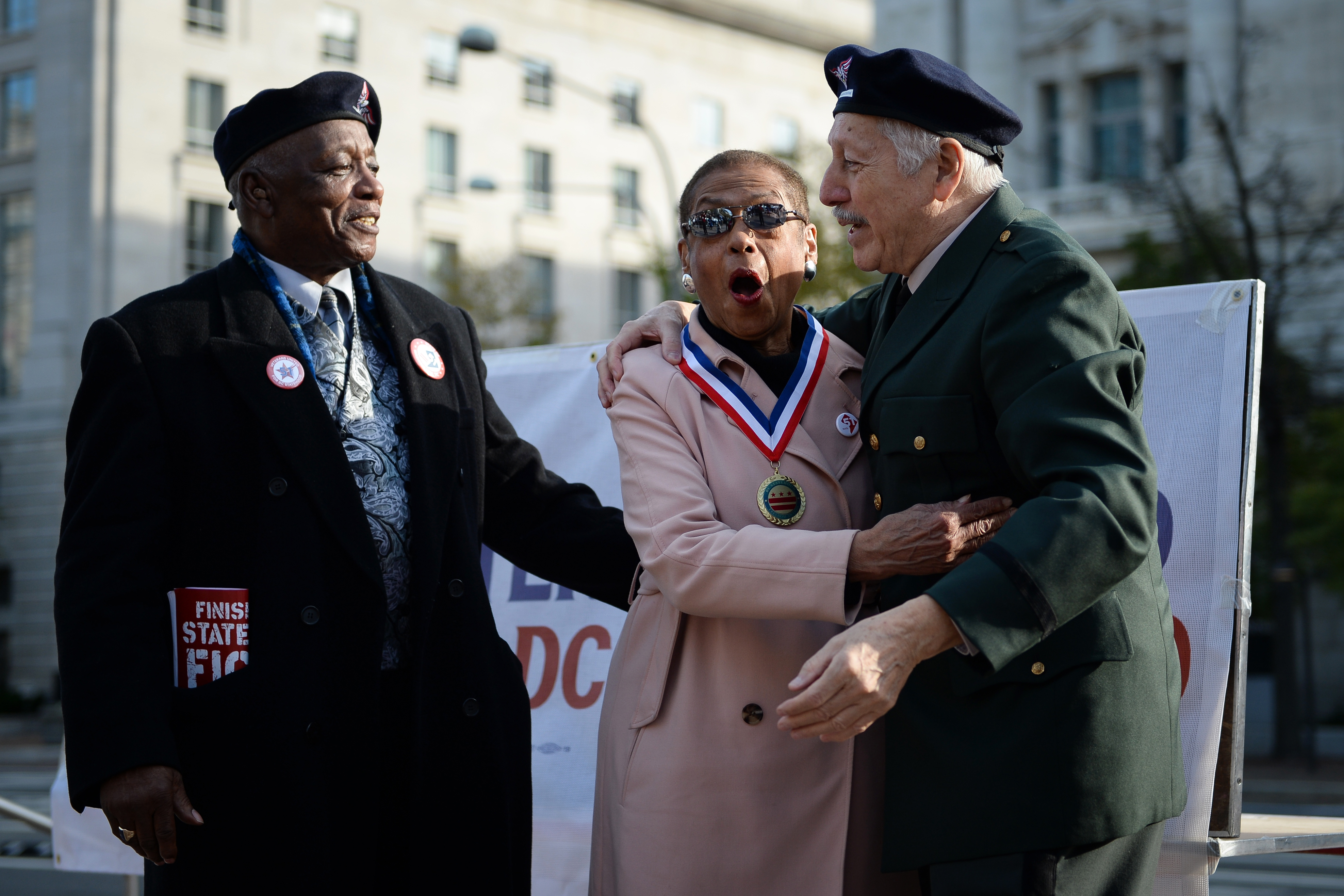 "UNITED STATES - NOVEMBER 11: Del. Eleanor Holmes Norton, D-D.C., center, receives the ""DC Statehood Freedom Award"" for her work fighting for D.C. equality at a rally sponsored by Veterans for D.C. Statehood on Veterans Day at Freedom Plaza on Monday Nov. 11, 2019. (Photo by Caroline Brehman/CQ Roll Call)"