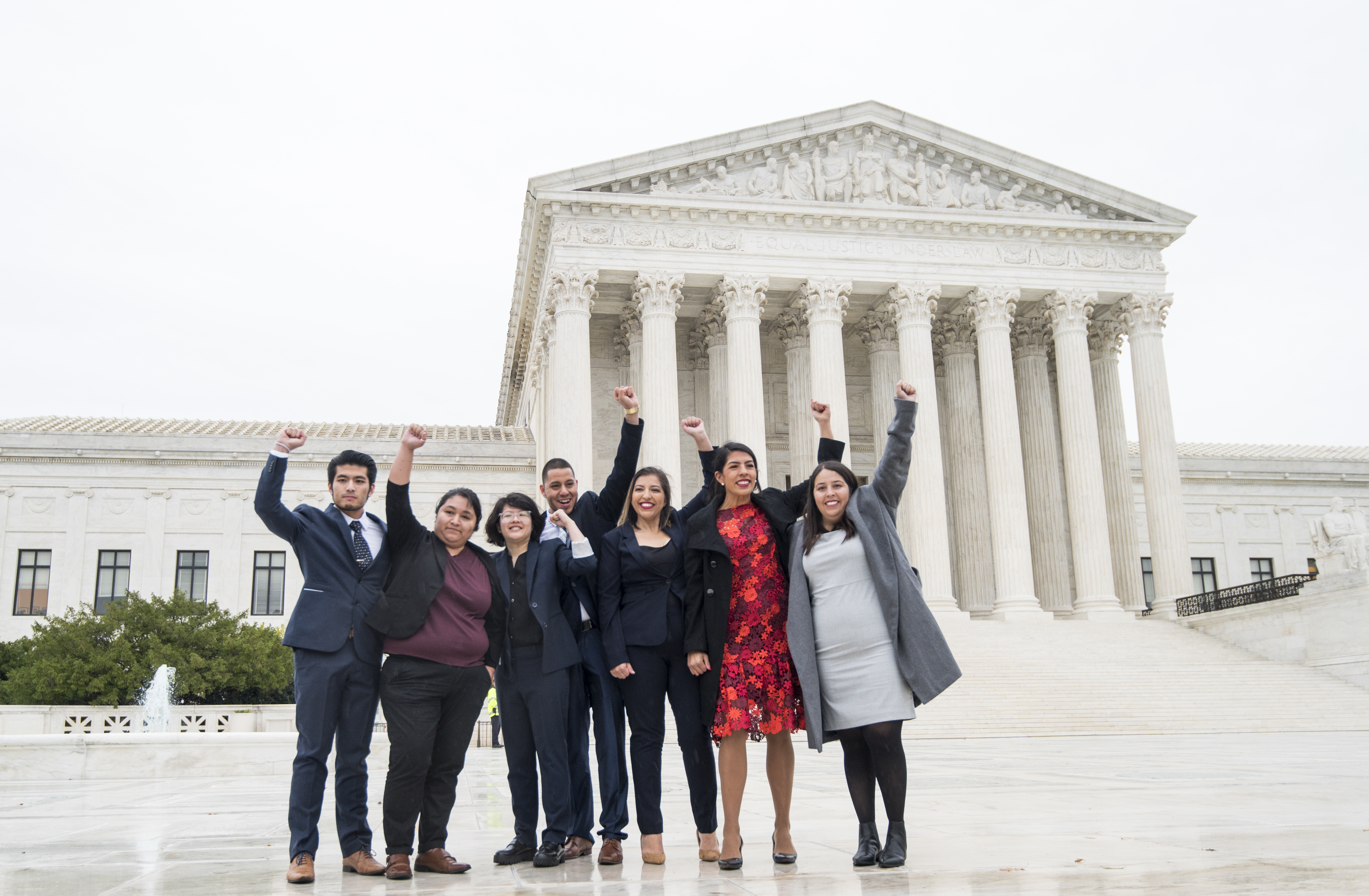 "UNITED STATES - NOVEMBER 12: DACA recipients, including Jirayut ""New"" Latthivongskorn (left) Carolina Fung Geng, (3rd from left), plaintiff Martin Batalla Vidal (center) and Eliana Fernández (3rd from right) hold their fists in the air as they enter the U.S. Supreme Court on Tuesday, Nov. 12, 2019. The court is hearing arguments on the Trump administration's decision to end the Deferred Action for Childhood Arrivals program. (Photo By Bill Clark/CQ Roll Call)"