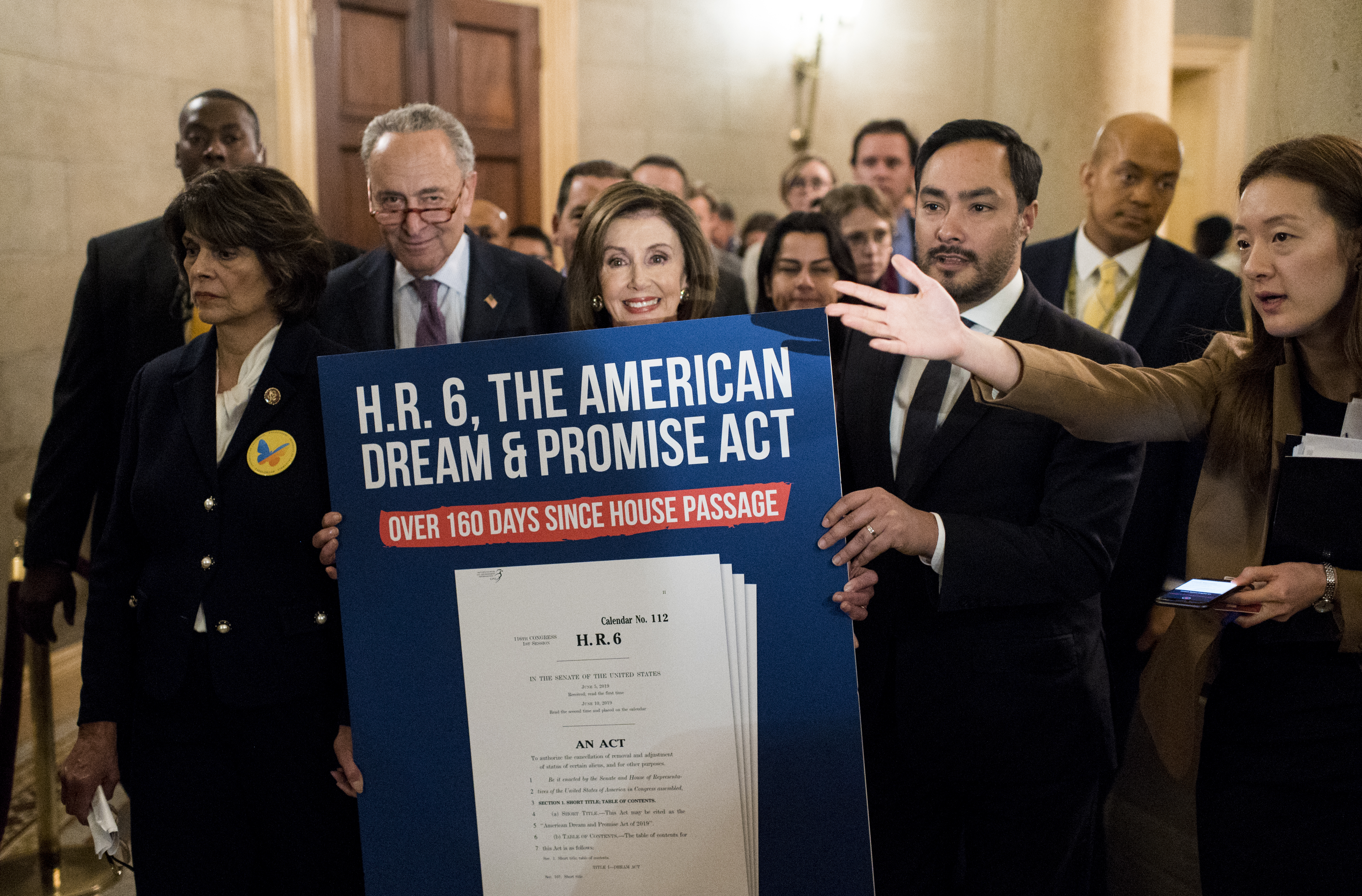 UNITED STATES - NOVEMBER 12: From left, Rep. Lucille Roybal-Allard, D-Calif., Senate Minority Leader Chuck Schumer, D-N.Y., Speaker of the House Nancy Pelosi, D-Calif., and Rep. Joaquin Castro, D-Texas, march to Senate Majority Leader Mitch McConnell's office in the Capitol to deliver a poster of the American Dream and Promise Act on Tuesday, Nov. 12, 2019. The march from the House side of the Capitol followed Democrats' press conference on the Supreme Court's oral arguments on the Trump administration's decision to end the Deferred Action for Childhood Arrivals programearlier in the day. (Photo By Bill Clark/CQ Roll Call)
