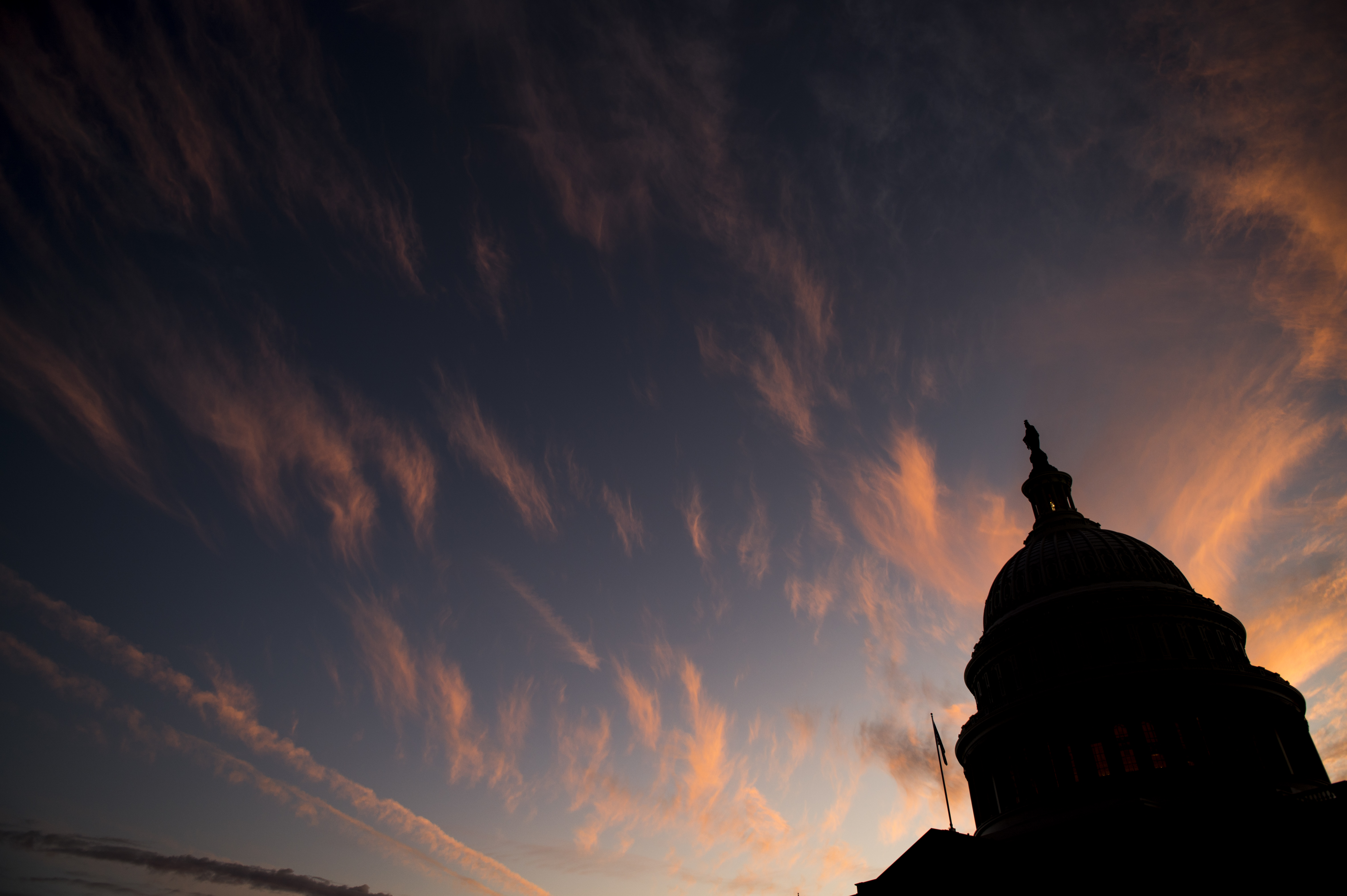 UNITED STATES - NOVEMBER 14: The sun sets over the U.S. Capitol dome on Thursday, Nov. 14, 2019. (Photo By Bill Clark/CQ Roll Call)