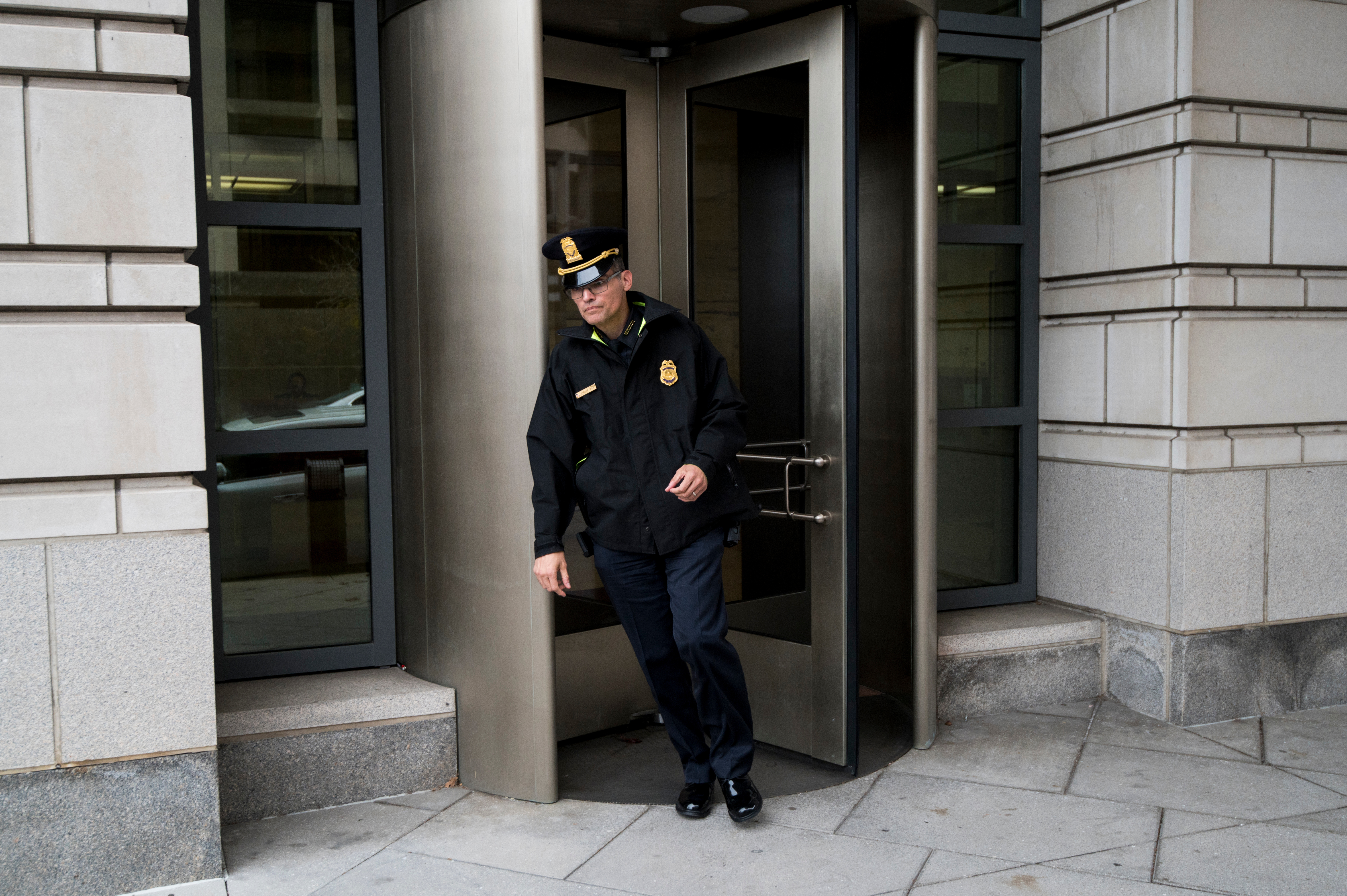 UNITED STATES - NOVEMBER 7: Tyrone Vias of the U.S. Capitol Police leaves the E. Barrett Prettyman Federal Courthousel on Thursday Nov. 7, 2019. (Photo By Bill Clark/CQ Roll Call)