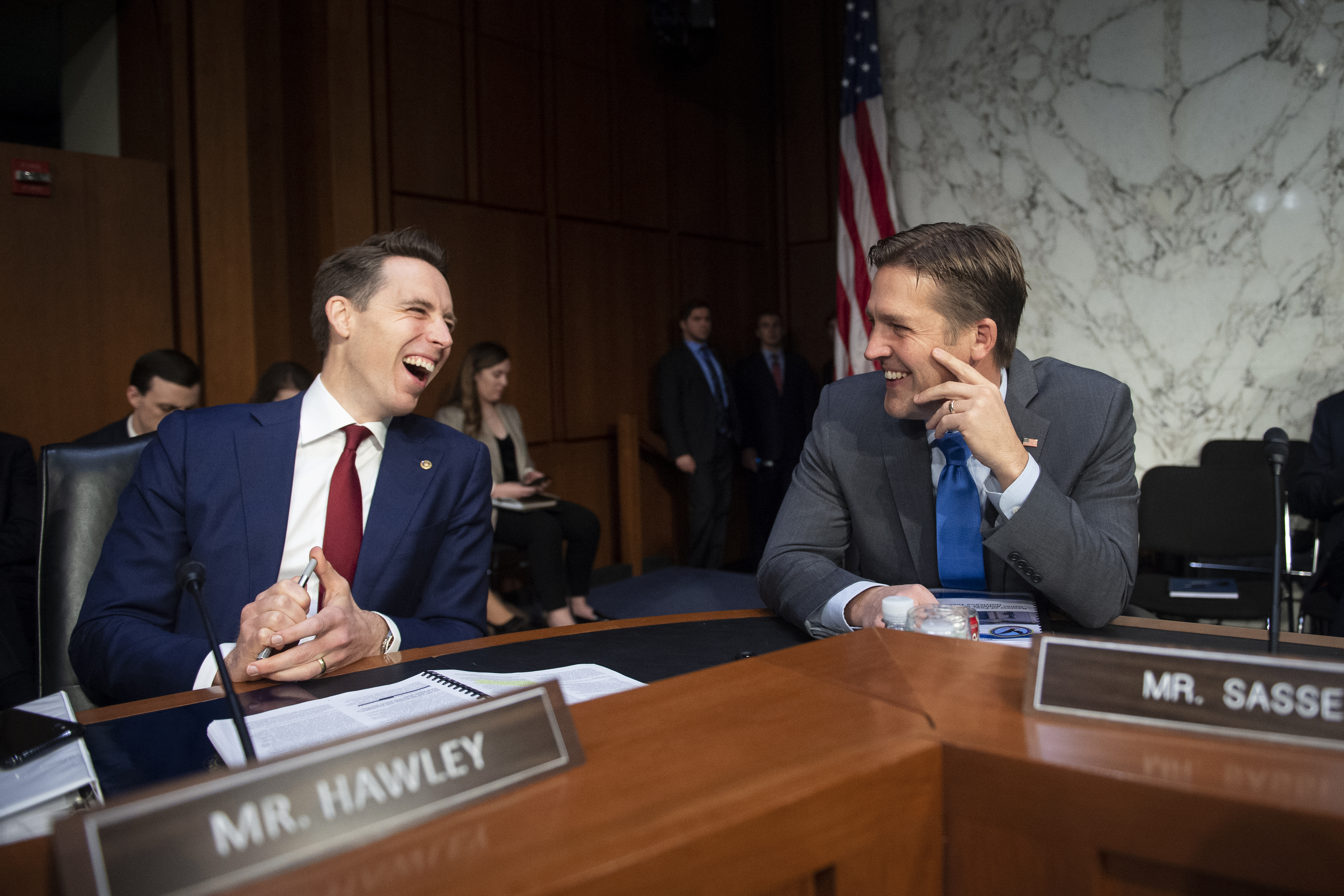 "UNITED STATES - DECEMBER 11: Sen. Josh Hawley, R-Mo., left, talks with Sen. Ben Sasse, R-Neb., before the start of Senate Judiciary Committee hearing on ""Examining the Inspector General's report on alleged abuses of the Foreign Intelligence Surveillance Act (FISA)"" on Wednesday Dec. 11, 2019. (Photo by Caroline Brehman/CQ Roll Call)"