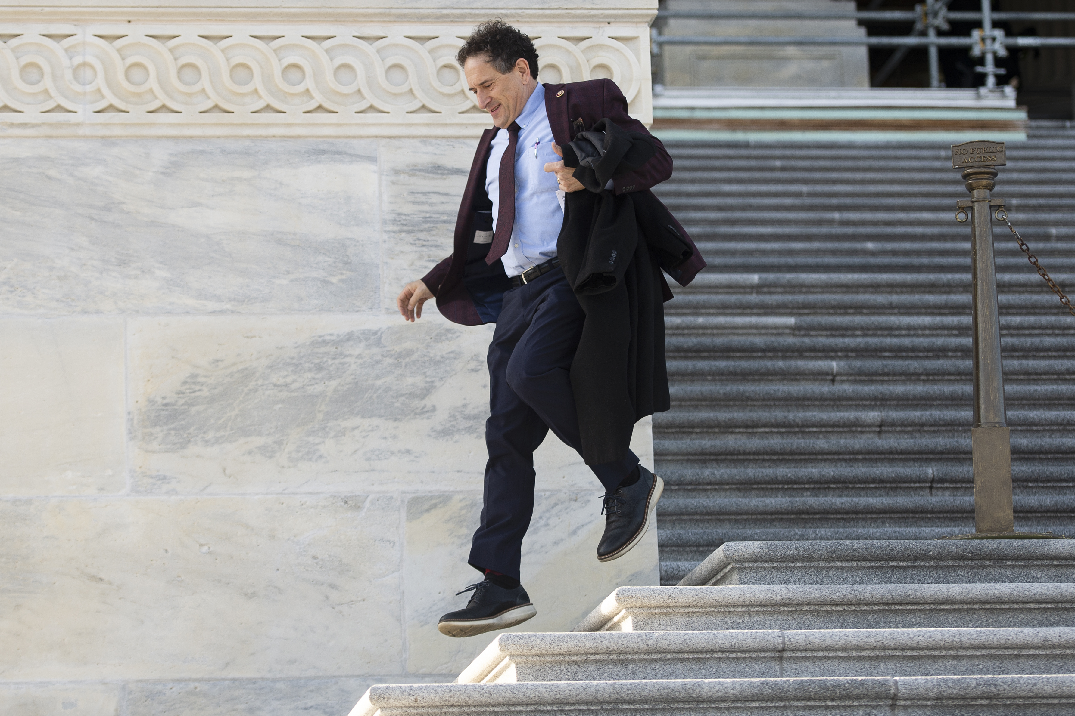 UNITED STATES - DECEMBER 12: Rep. Andy Levin, D-Mich., runs down the House steps after the final votes of the week on Thursday Dec. 12, 2019. (Photo by Caroline Brehman/CQ Roll Call)