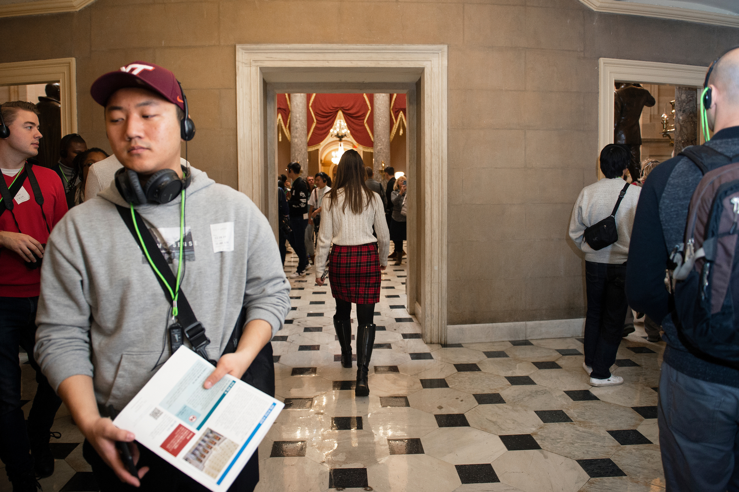 Tour groups fill the hallway outside of Statuary Hall on Wednesday. (Caroline Brehman/CQ Roll Call)
