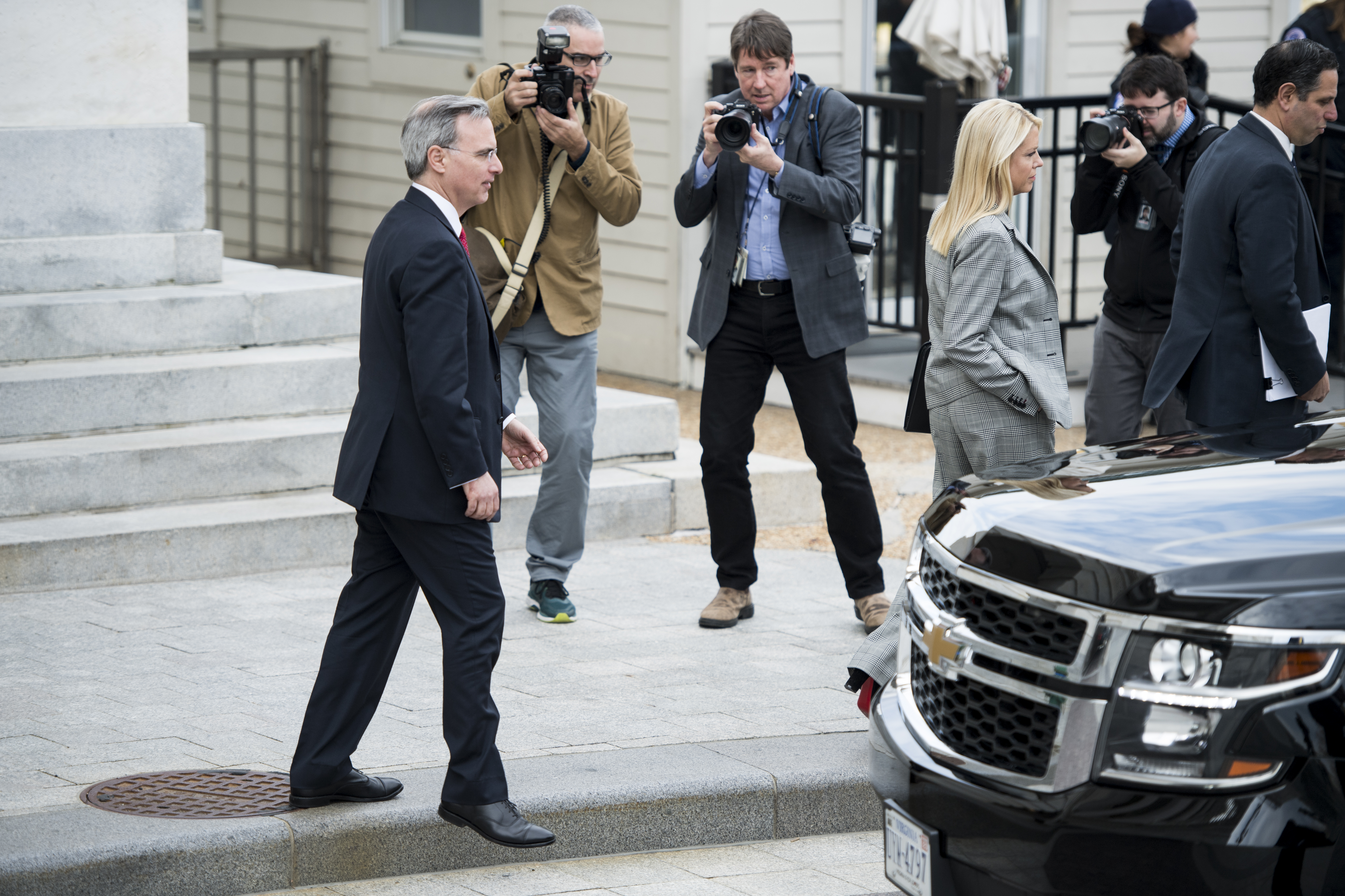 UNITED STATES - DECEMBER 4: White House Counsel Pat Cipollone and Pam Bondi leaves the Capitol after attending the Senate Republicans' lunch on Wednesday, Dec. 4, 2019. (Photo By Bill Clark/CQ Roll Call)