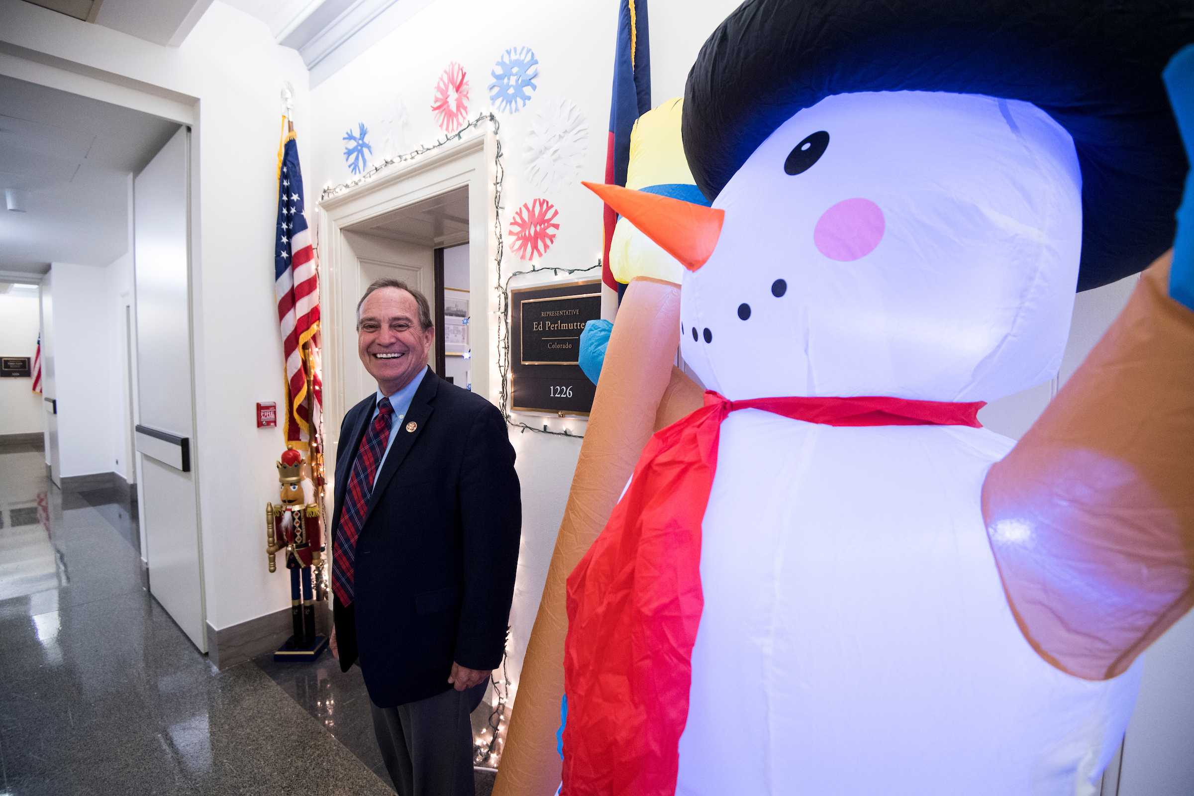 Colorado Rep. Ed Perlmutter with the inflatable snowman outside his office in Longworth that became the focus of a rivalry with Democrat Jason Crow. (Bill Clark/CQ Roll Call)