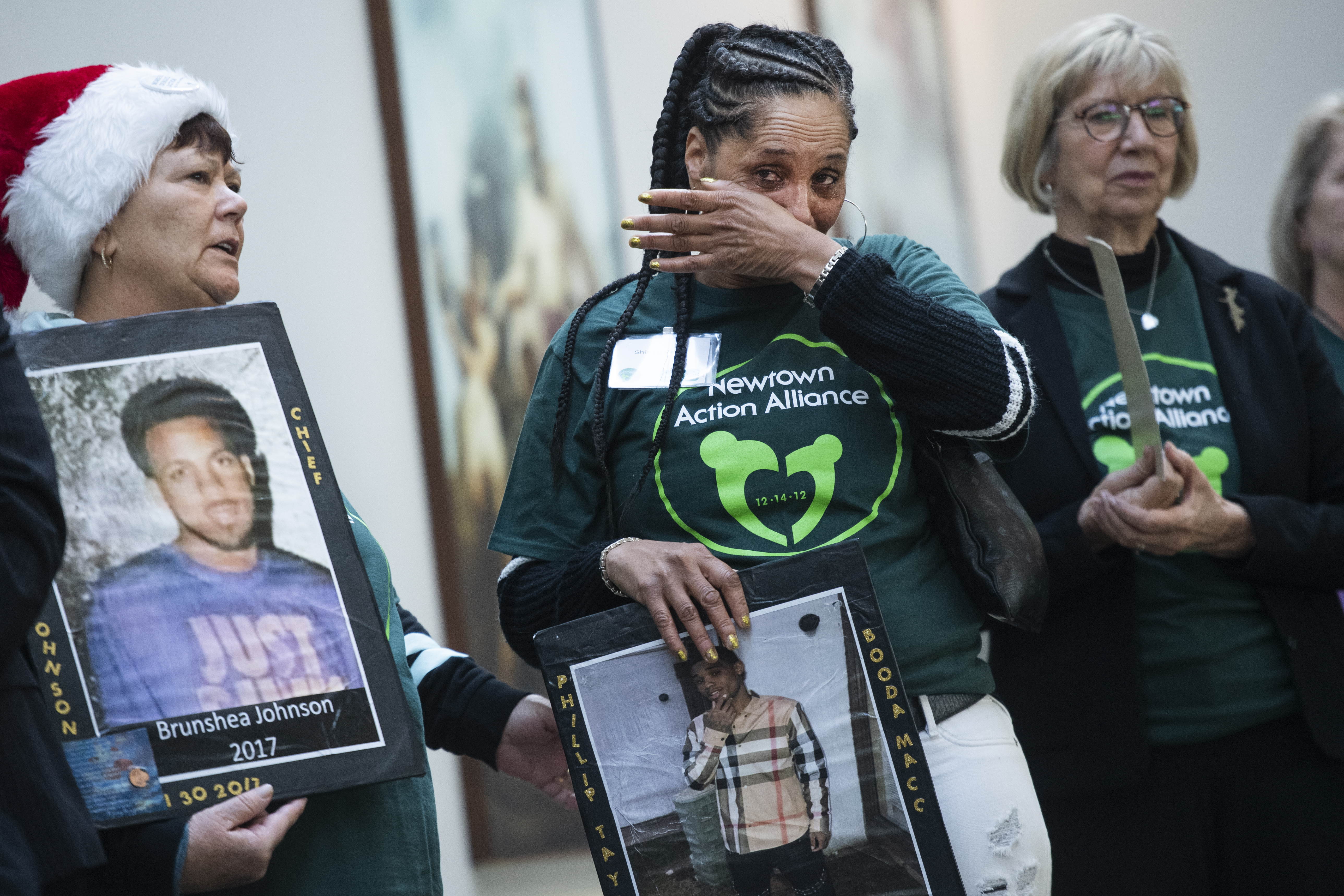 """UNITED STATES - DECEMBER 5: Shirley Carter holds a pictures of her son, Phillip Taylor, who was killed in Dallas in 2017, during a rally in Hart Building to call for """"action on gun violence prevention,"""" on Thursday, December 5, 2019. (Photo By Tom Williams/CQ Roll Call)"""