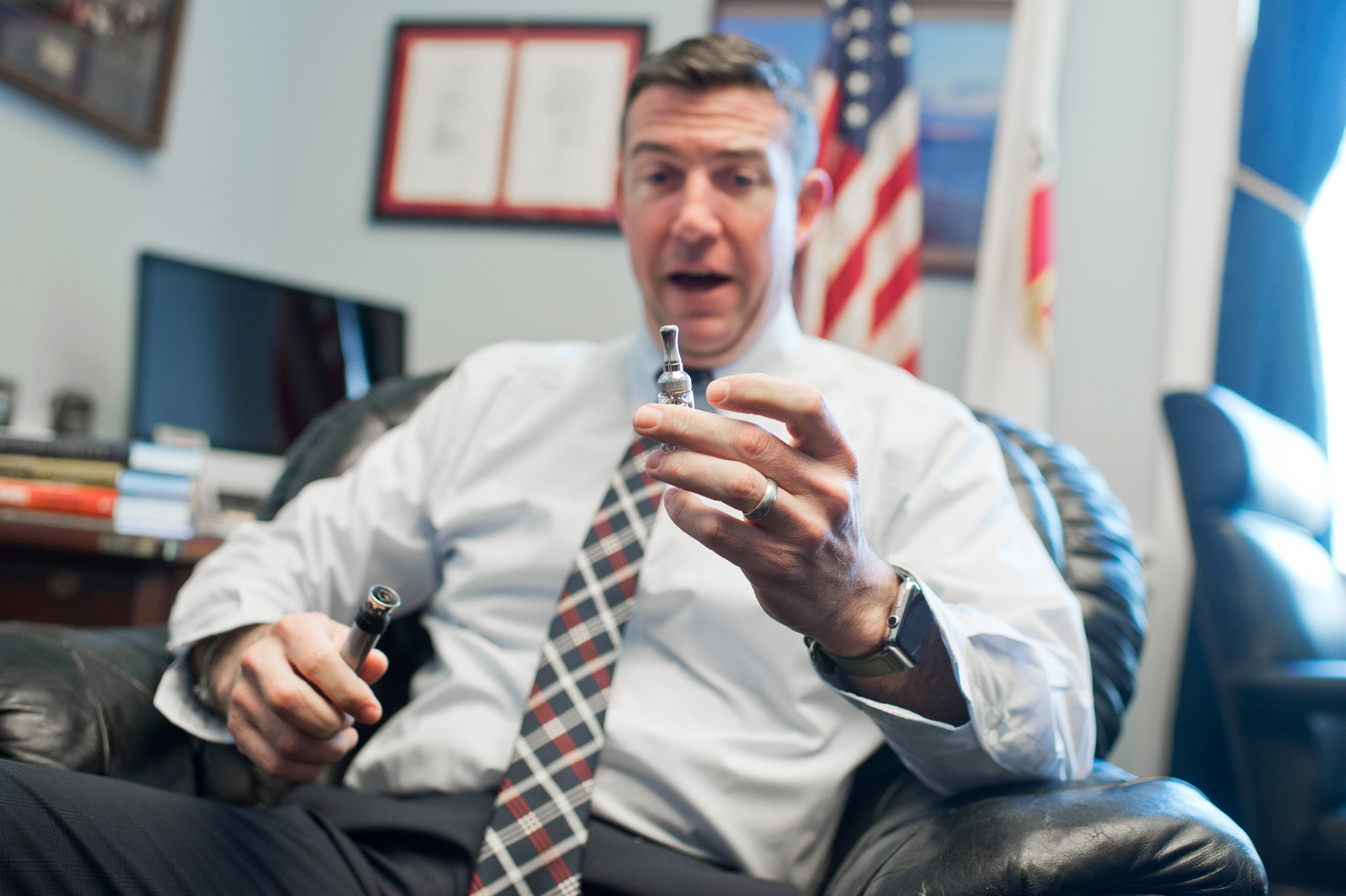UNITED STATES - JANUARY 13: Rep. Duncan Hunter, R-Calif., is interviewed about his vaporizer pen in his Rayburn office, January 13, 2016. (Photo By Tom Williams/CQ Roll Call)