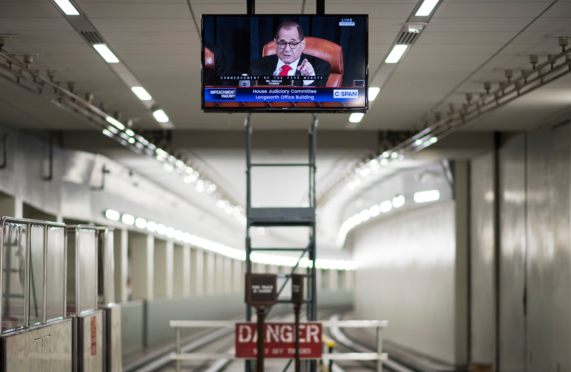 """UNITED STATES - DECEMBER 9: Chairman Jerrold Nadler, D-N.Y., appears on a tv monitor in the Rayburn subway as he calls for a recess in the House Judiciary Committee hearing on """"Counsel Presentations of Evidence in the Impeachment Inquiry of President Donald Trump."""" on Monday, Dec. 9, 2019. (Photo By Bill Clark/CQ Roll Call)"""