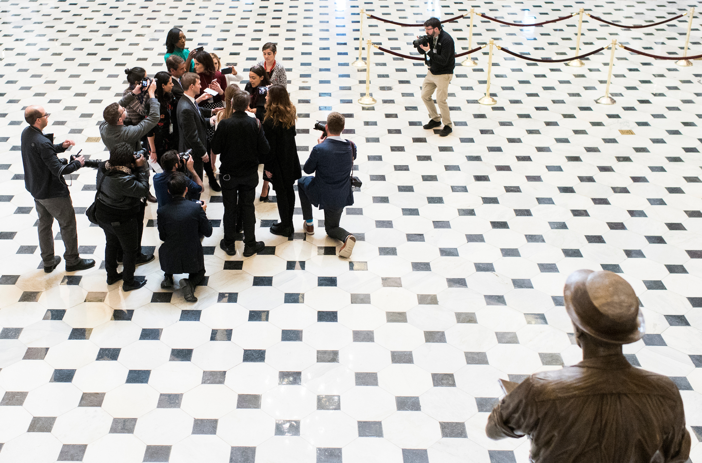 Rep. Alexandria Ocasio-Cortez, D-N.Y., stops to talk to reporters in Statuary Hall on Wednesday as the House begins debate on the articles of impeachment against President Donald Trump. (Bill Clark/CQ Roll Call)