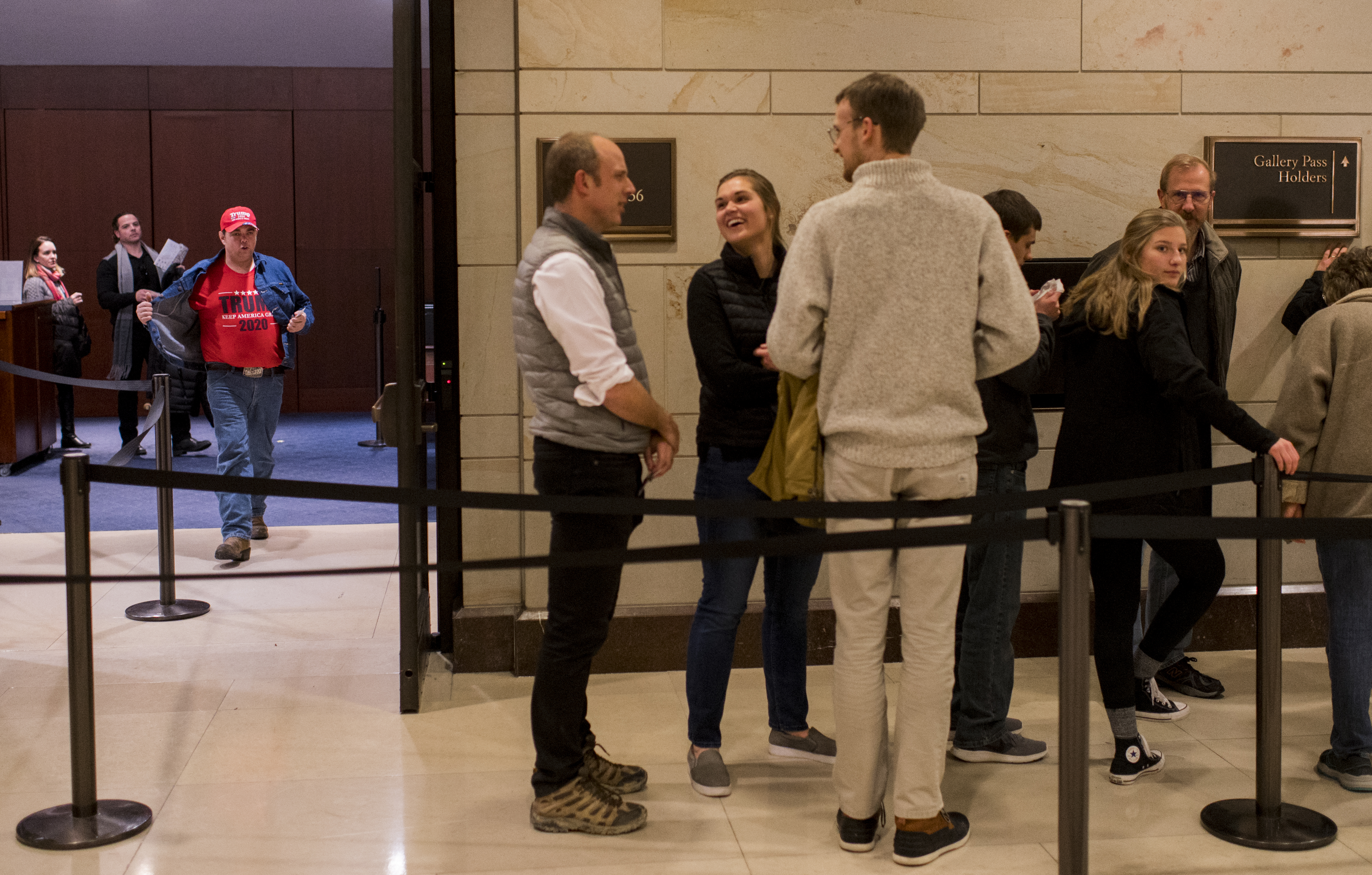 UNITED STATES - DECEMBER 18: Members of the public line up in the Capitol Visitor Center to go watch the House of Representatives articles of impeachment votes against President Donald Trump in the Capitol on Wednesday, Dec. 18, 2019. (Photo By Bill Clark/CQ Roll Call)