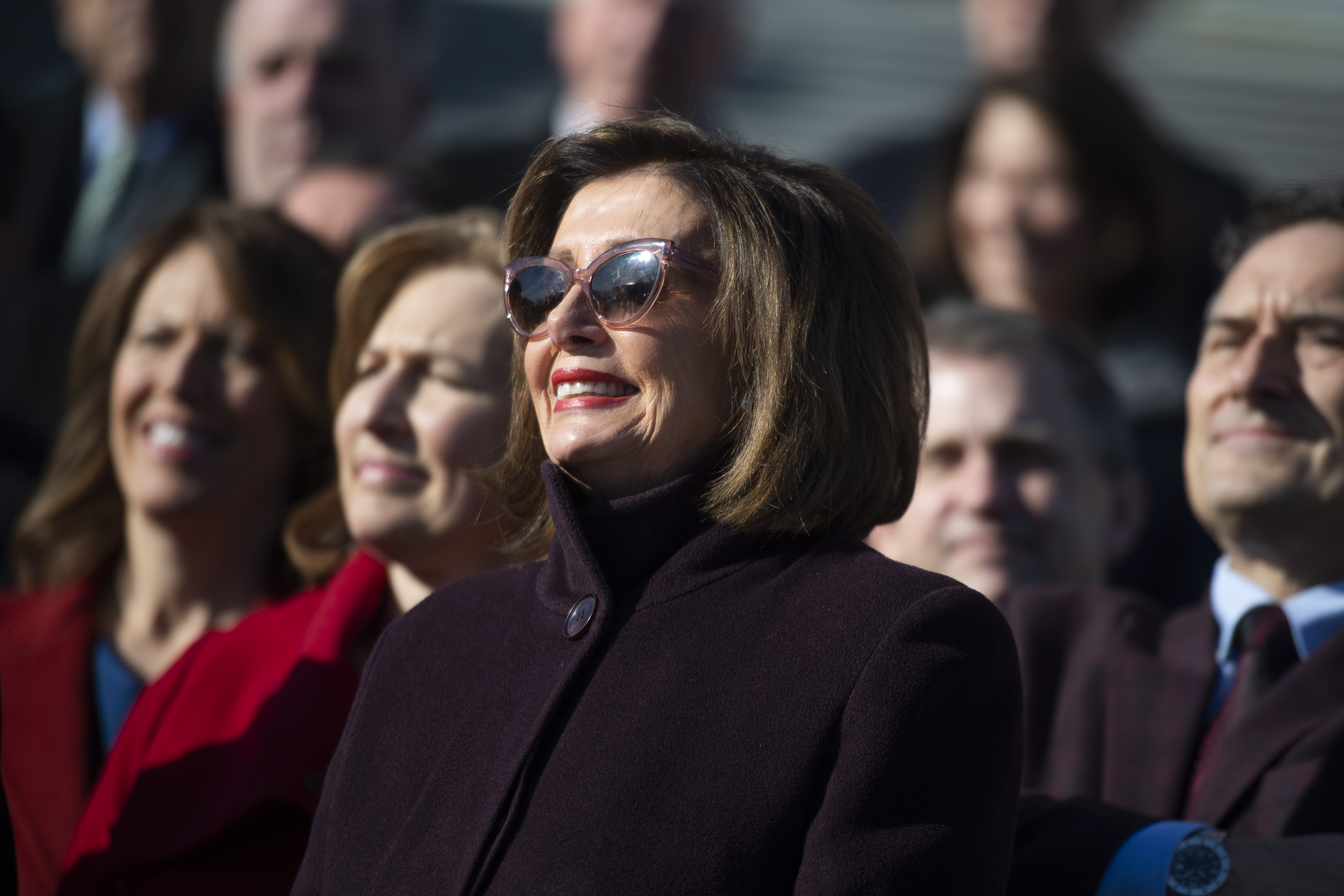 "UNITED STATES - DECEMBER 12: Speaker of the House Nancy Pelosi, D-Calif., attends a rally on the House steps of the Capitol with other members on the ""Lower Drug Costs Now Act,"" on Thursday, December 12, 2019. (Photo By Tom Williams/CQ Roll Call)"