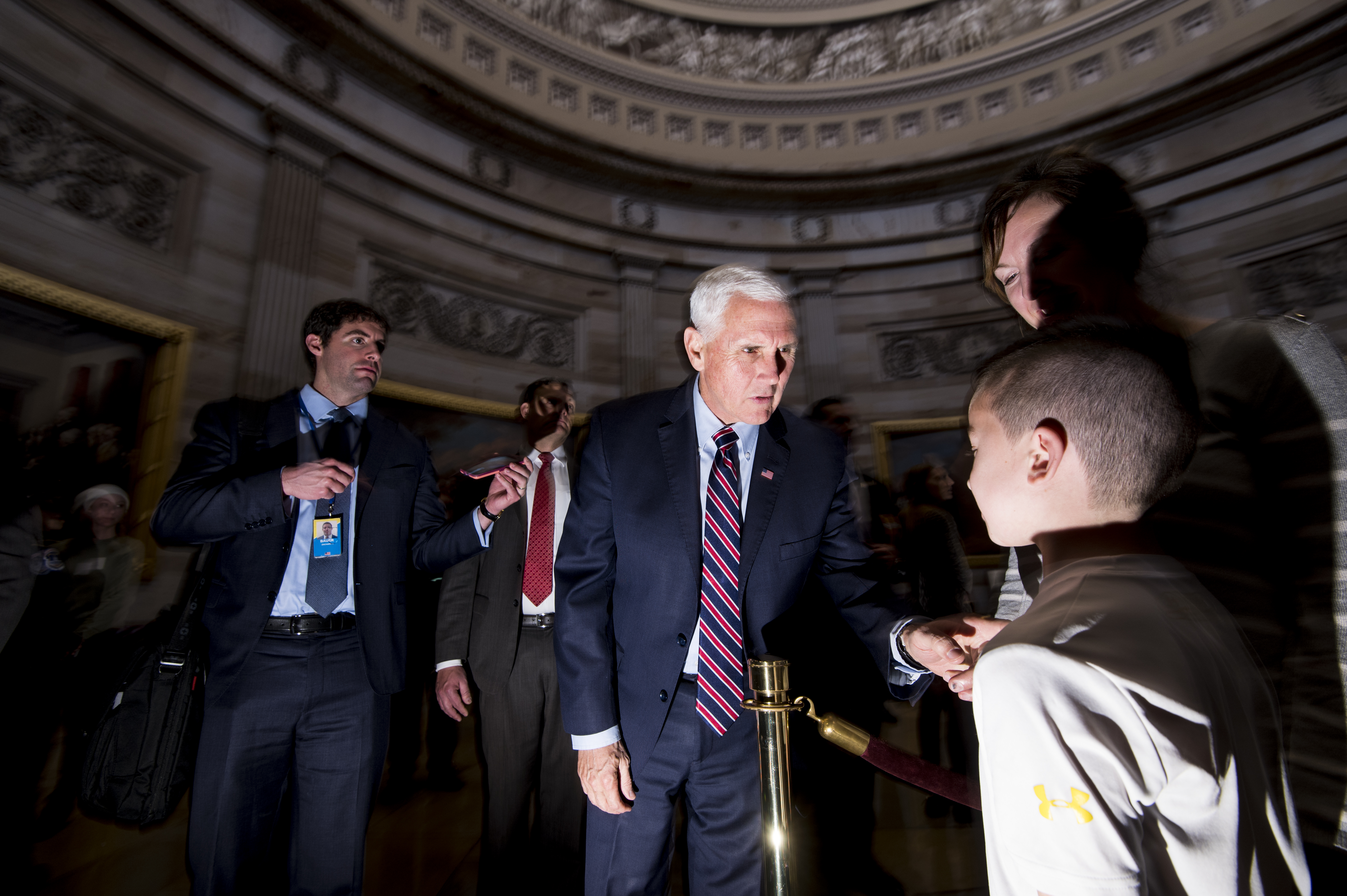 UNITED STATES - DECEMBER 17: Vice President Mike Pence chats with tourists in the Capitol Rotunda as he leaves the Senate Republicans' policy lunch on Tuesday, Dec. 17, 2019. (Photo By Bill Clark/CQ Roll Call)