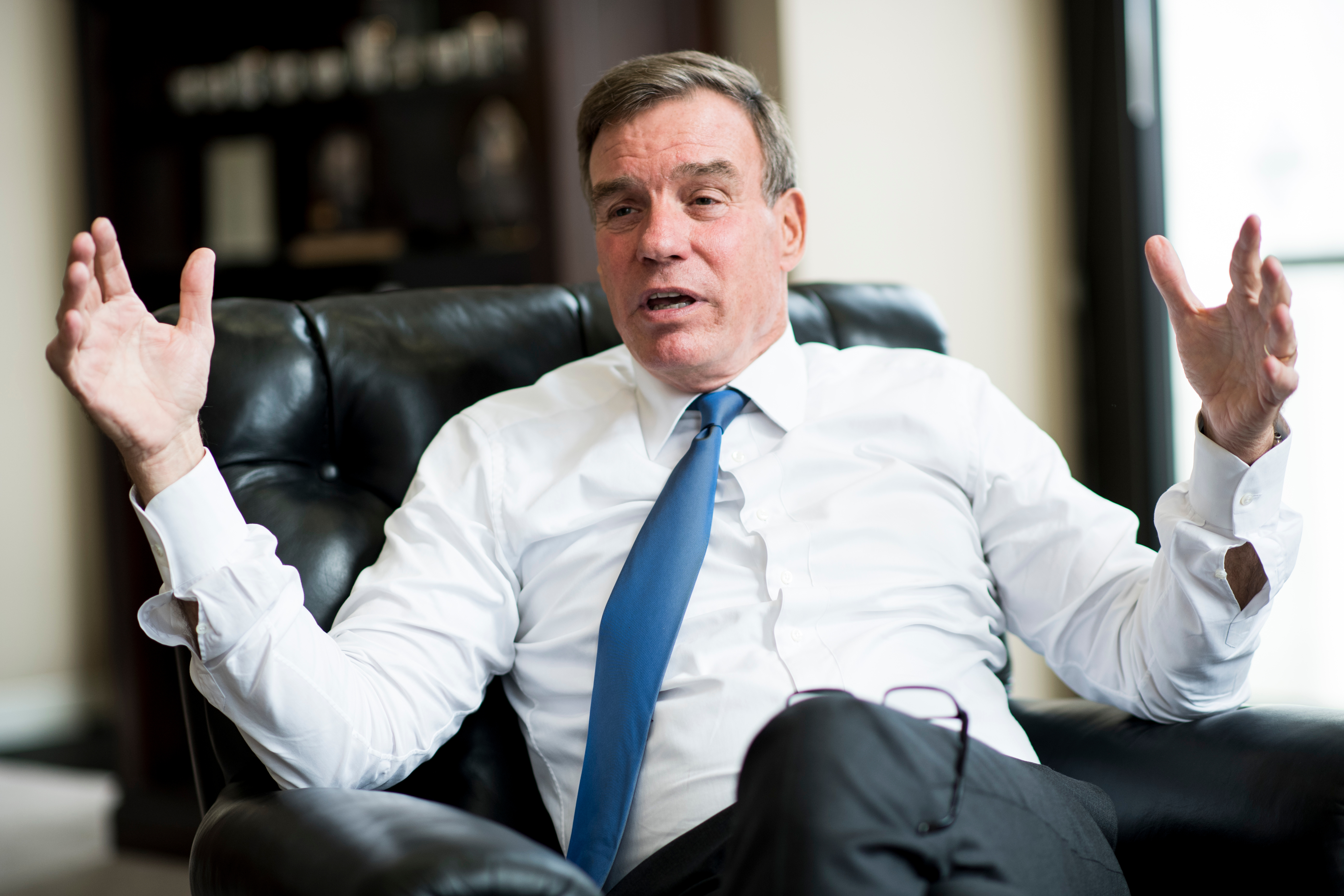 UNITED STATES - SEPTEMBER 25: Sen. Mark Warner, D-Va., speaks with Roll Call in his office in the Hart Senate Office Building on Tuesday, Sept. 25, 2018. (Photo By Bill Clark/CQ Roll Call)