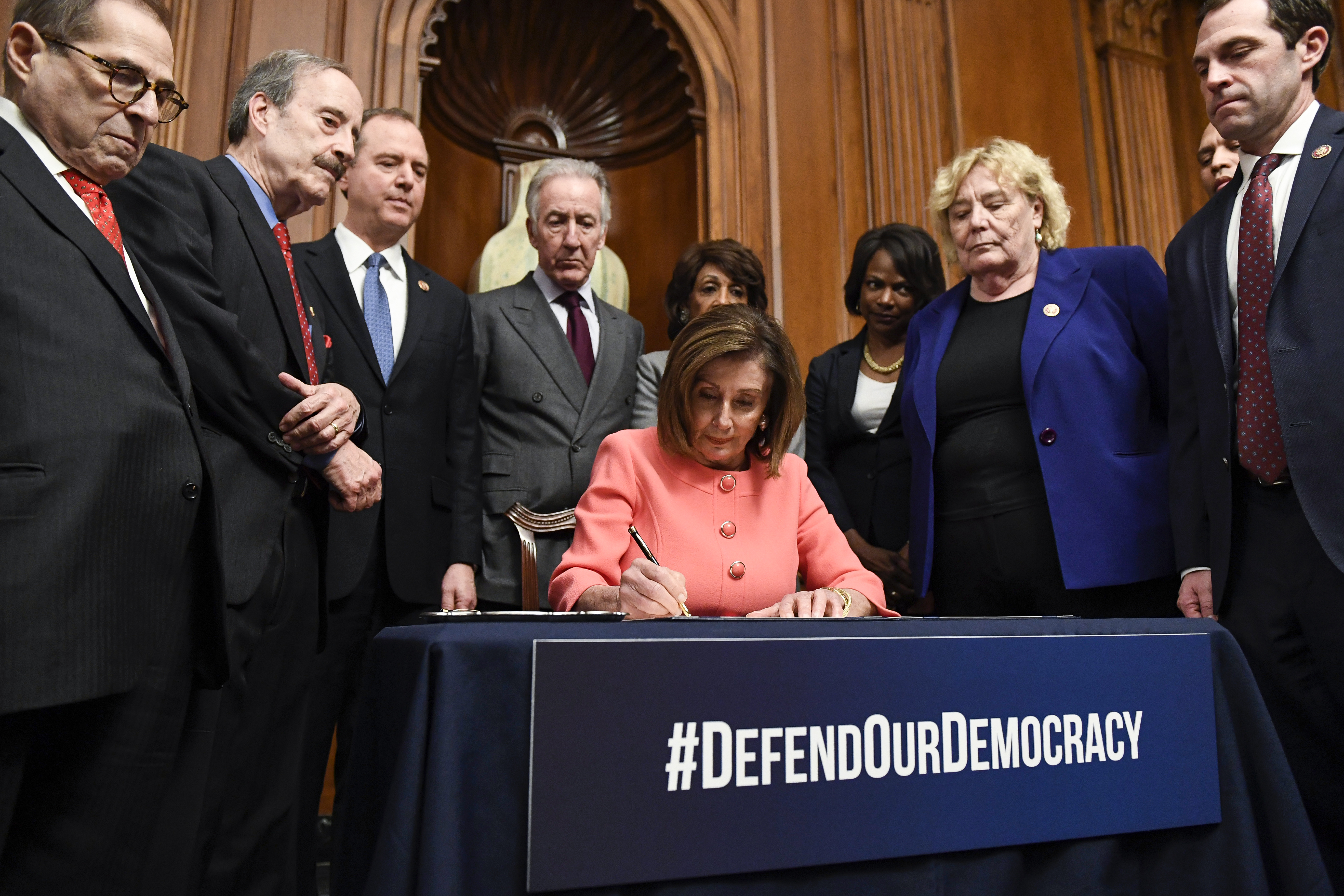 UNITED STATES - JANUARY 15: Speaker of the House Nancy Pelosi, D-Calif., signs the resolution to transmit the two articles of impeachment against President Donald Trump to the Senate for trial on Capitol Hill on Wednesday, Jan. 15, 2020. (Photo by Caroline Brehman/CQ Roll Call)