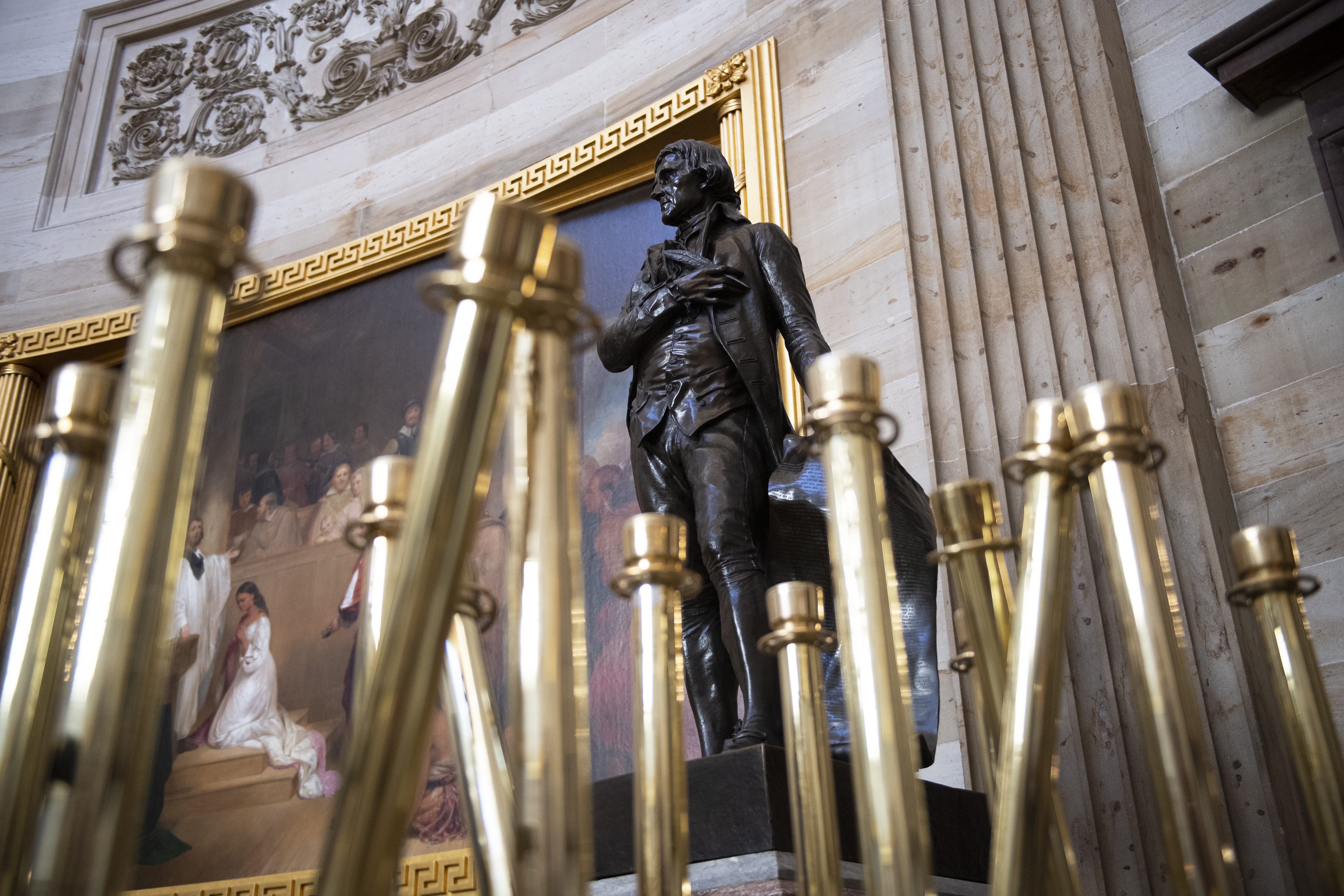 UNITED STATES - JANUARY 15: Stanchions frame a statue of Thomas Jefferson in the Capitol Rotunda in advance of the transmission of the articles of impeachment from the House to the Senate on Wednesday, Jan. 15, 2020. (Photo by Caroline Brehman/CQ Roll Call)