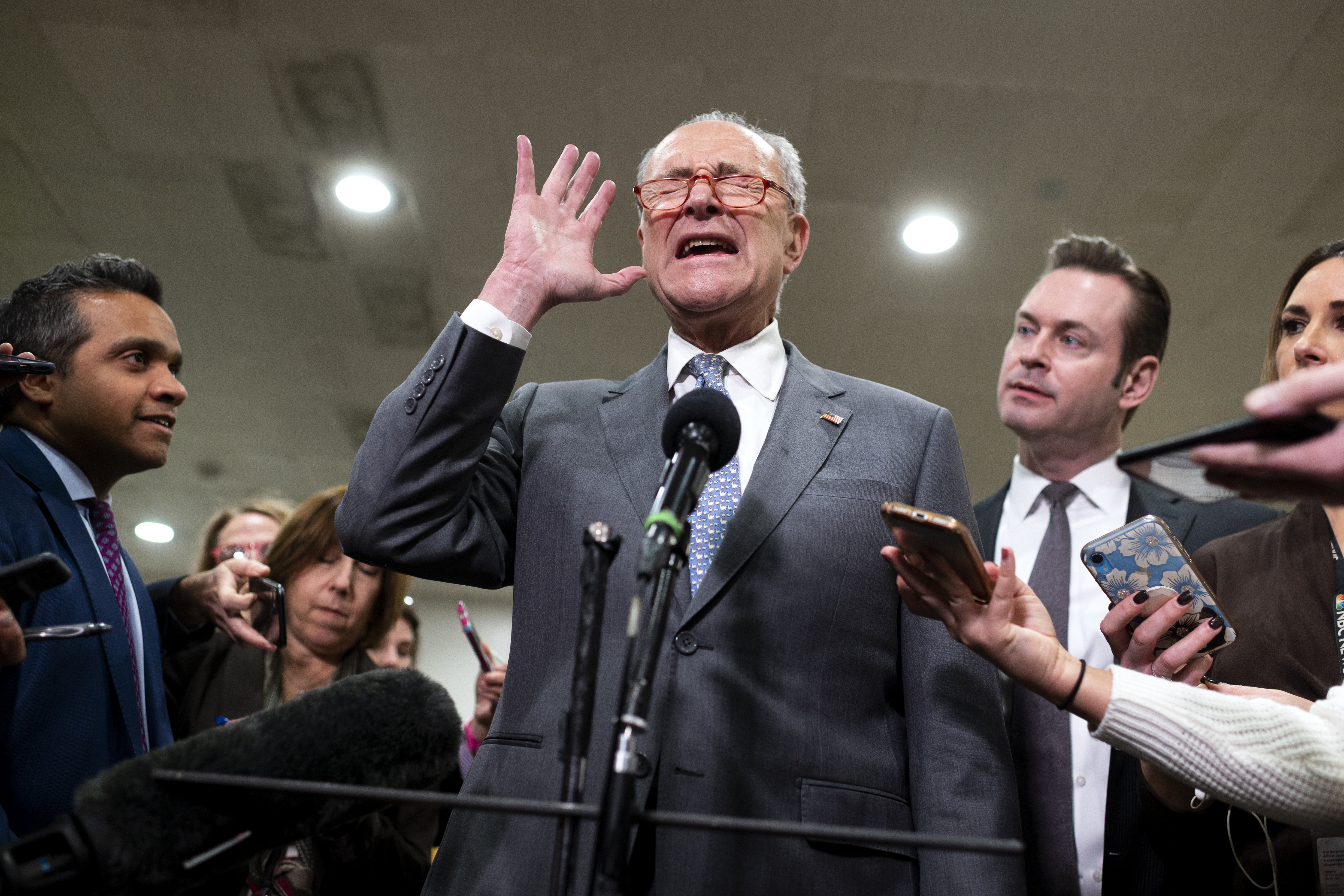 UNITED STATES - JANUARY 27: Senate Minority Leader Chuck Schumer, D-N.Y., tells reporters to ask questions one at a time during a news conference during a break in the impeachment trial of President Donald Trump on Monday, Jan. 27, 2020. (Photo by Caroline Brehman/CQ Roll Call)