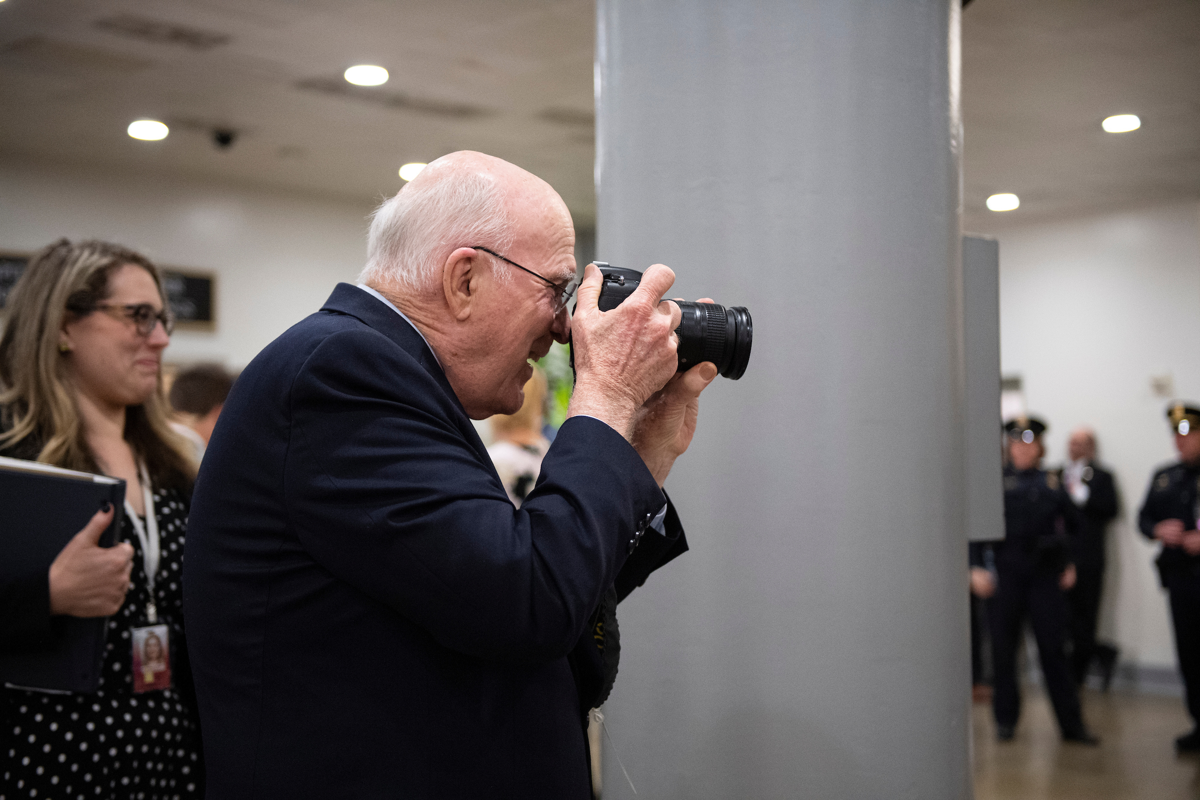 UNITED STATES - JANUARY 22: Sen. Patrick Leahy, D-Vt., takes a photograph of the reporters in the Senate Subway during a break in the Senate impeachment trial of President Donald Trump on Wednesday, Jan. 22, 2020. (Photo by Caroline Brehman/CQ Roll Call)