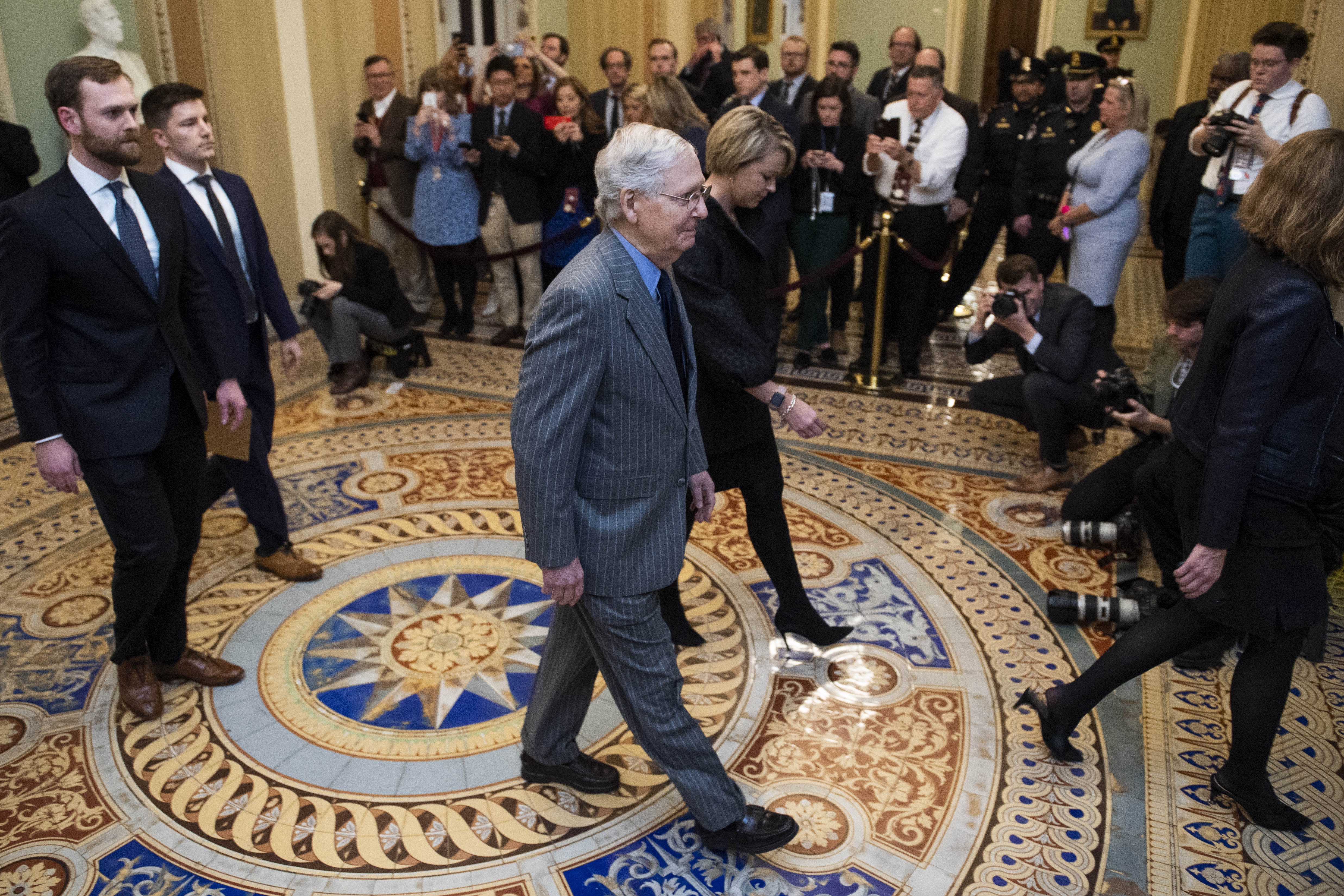 UNITED STATES - JANUARY 15: Senate Majority Leader Mitch McConnell, R-Ky., makes his way to the Senate floor before House impeachment managers Reps. Adam Schiff, D-Calif., Jerrold Nadler, D-N.Y., Zoe Lofgren, D-Calif., Hakeem Jeffries, D-N.Y., Jason Crow, D-Colo., Val Demings, D-Fla., and Sylvia Garcia, D-Texas, delivered articles of impeachment against President Donald Trump on Wednesday, January 15, 2020. (Photo By Tom Williams/CQ Roll Call)