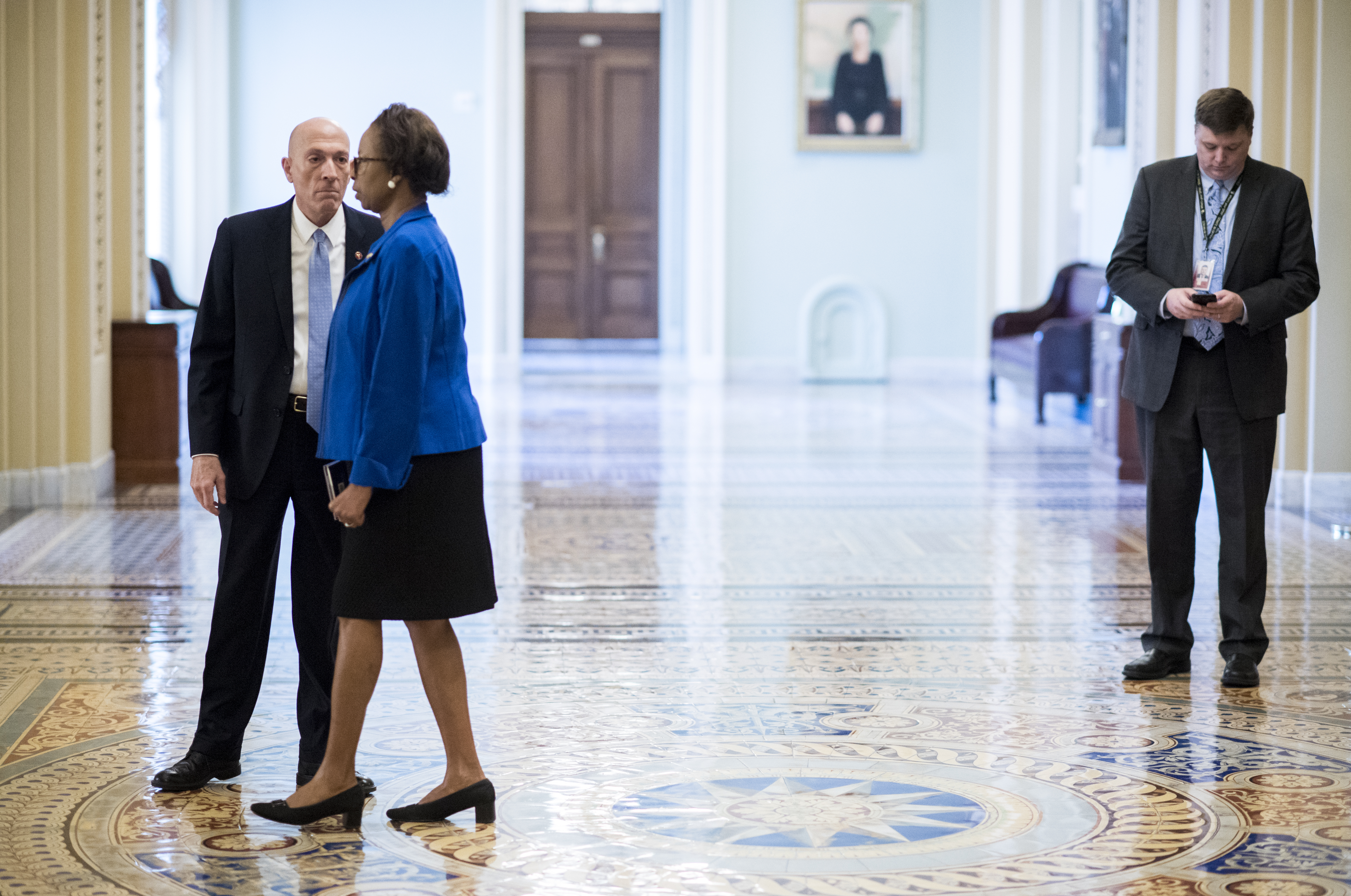 UNITED STATES - JANUARY 15: Sergeant at Arms of the U.S. House of Representatives Paul Irving and Clerk of the United States House of Representatives Cheryl Johnson walk through the Ohio Clock Corridor in advance of the tramission of the artciles of impeachment from the House to the Senate on Wednesday, Jan. 15, 2020. (Photo By Bill Clark/CQ Roll Call)