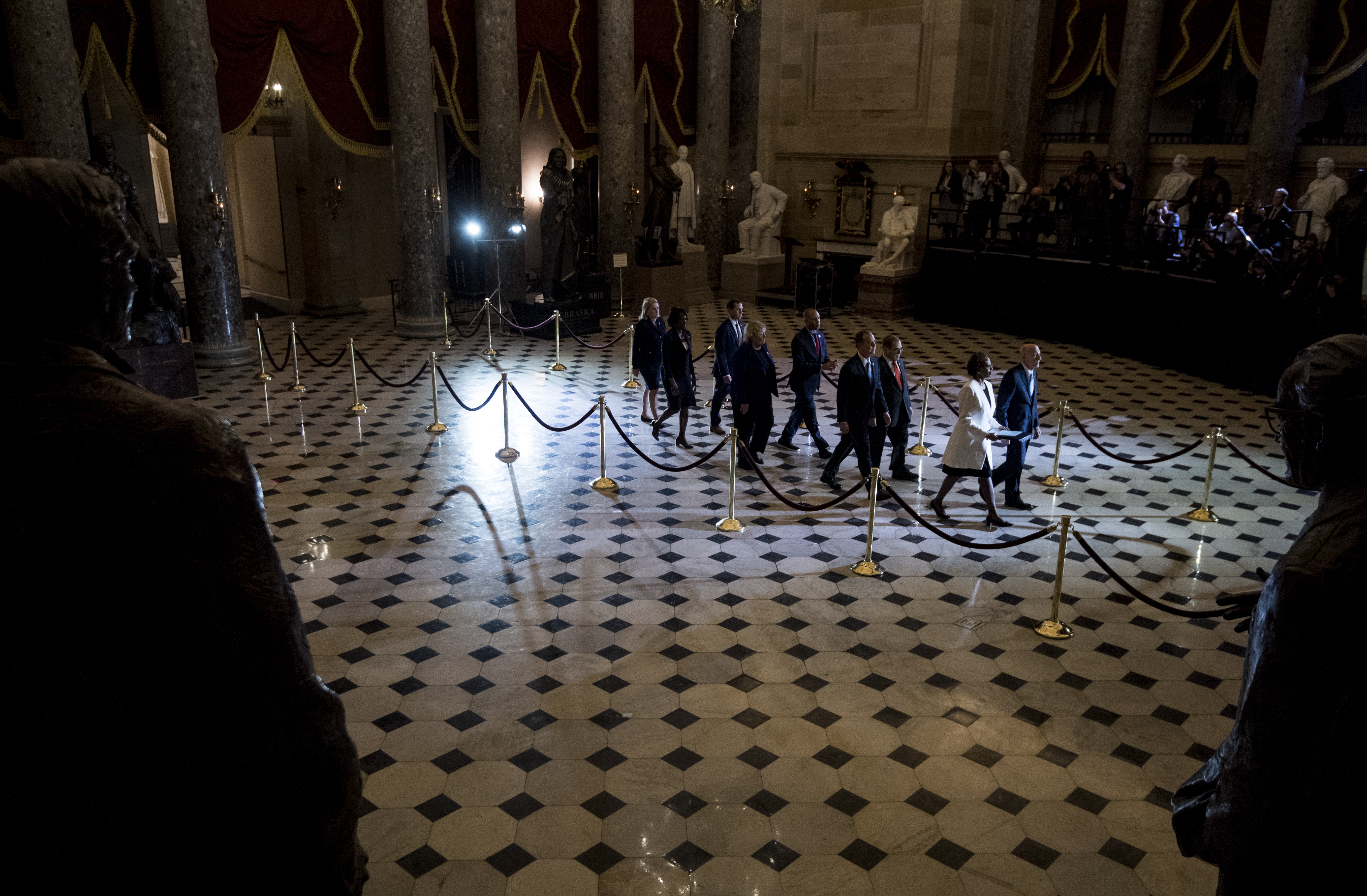 UNITED STATES - JANUARY 15: Sergeant at Arms of the U.S. House of Representatives Paul Irving and Clerk of the United States House of Representatives Cheryl Johnson lead the House managers through Statuary Hall to deliver the of the artciles of impeachment from the House to the Senate on Wednesday, Jan. 15, 2020. (Photo By Bill Clark/CQ Roll Call)