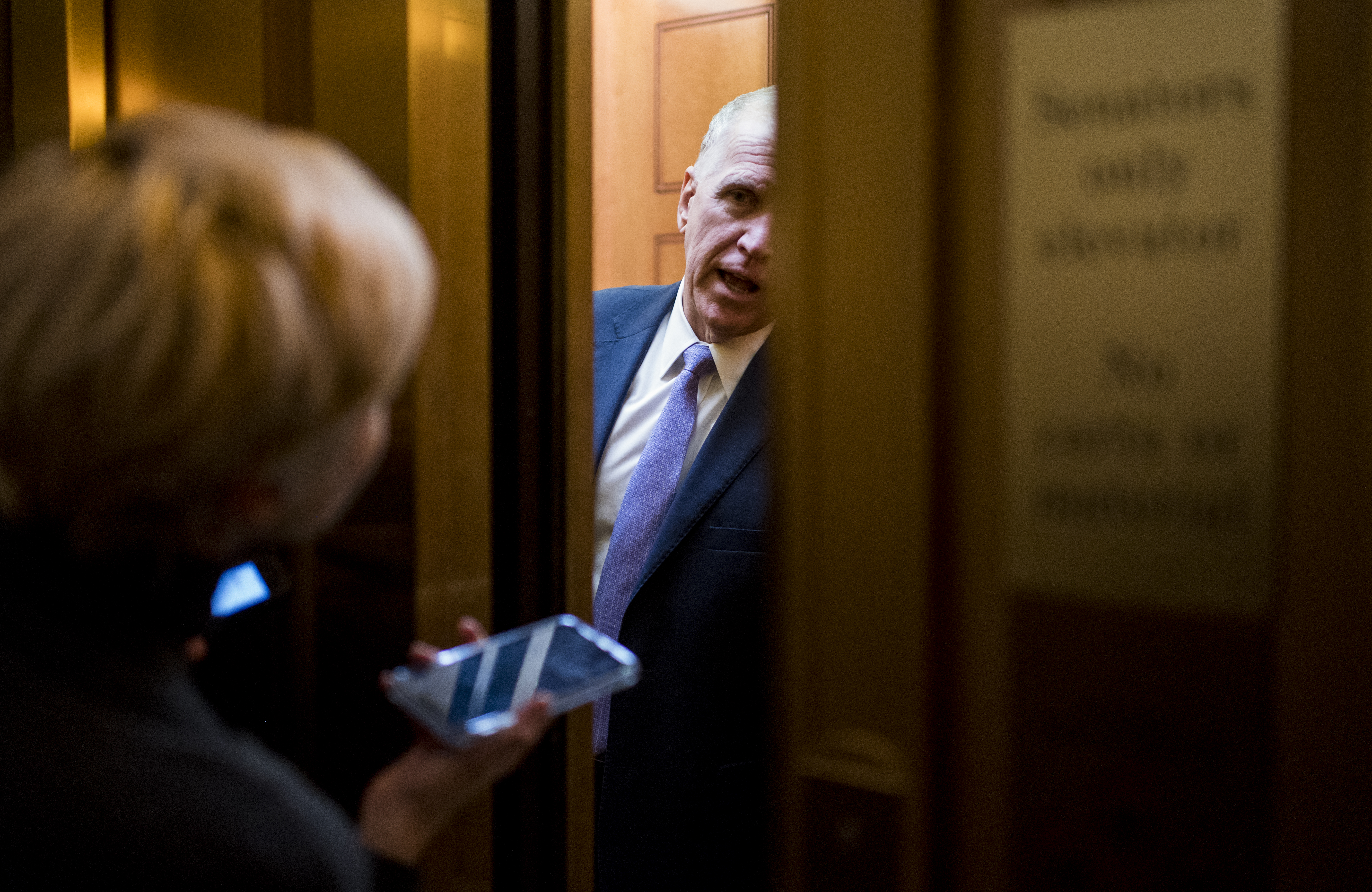 UNITED STATES - JANUARY 28: Sen. Thom Tillis, R-N.C., speaks with reporters through the closing elevator doors before the start of the Senate impeachment trial proceedings on Tuesday, Jan. 28, 2020. (Photo By Bill Clark/CQ Roll Call)