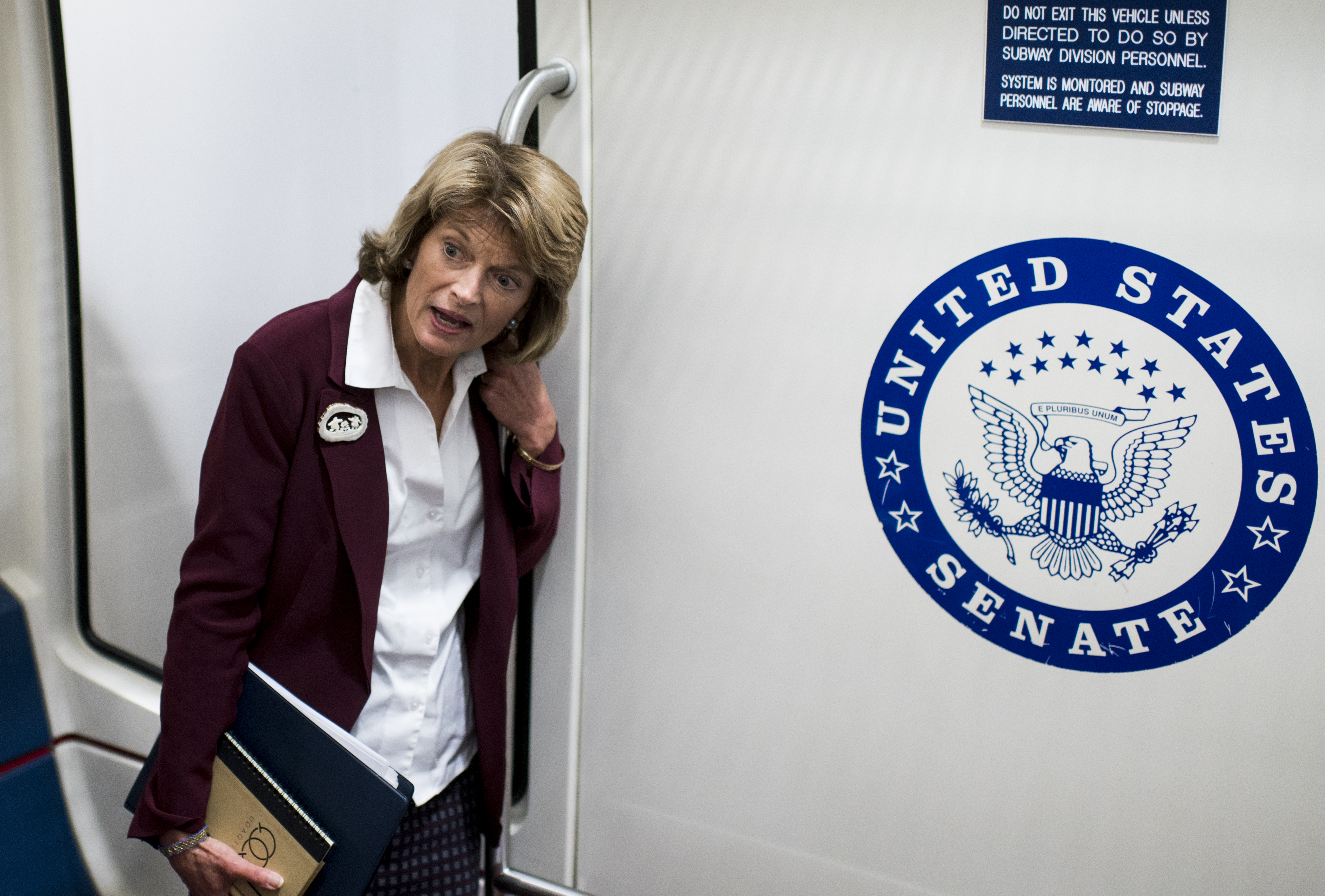 UNITED STATES - JANUARY 28: Sen. Lisa Murkowski, R-Alaska, speaks with reporters in the Senate subway as she leaves the Senate Republicans' caucus meeting to discuss witnesses for the Senate impeachment trial proceedings on Tuesday, Jan. 28, 2020. (Photo By Bill Clark/CQ Roll Call)