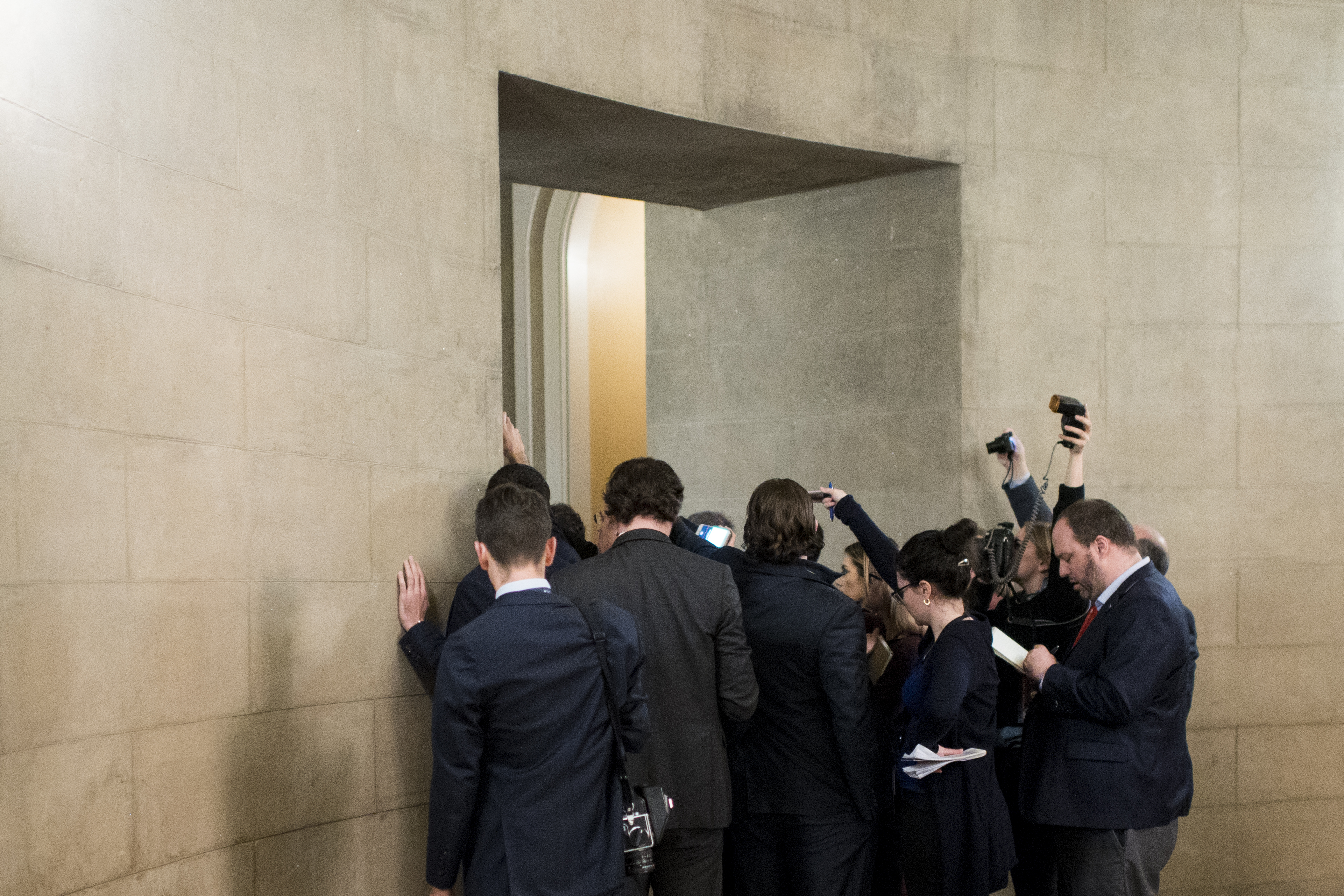UNITED STATES - JANUARY 28: Reporters crowd around Sen. Lindsey Graham, R-S.C., in the hallway just off the Rotunda as he leaves the Senate Republicans' caucus meeting to discuss witnesses for the Senate impeachment trial proceedings on Tuesday, Jan. 28, 2020. (Photo By Bill Clark/CQ Roll Call)